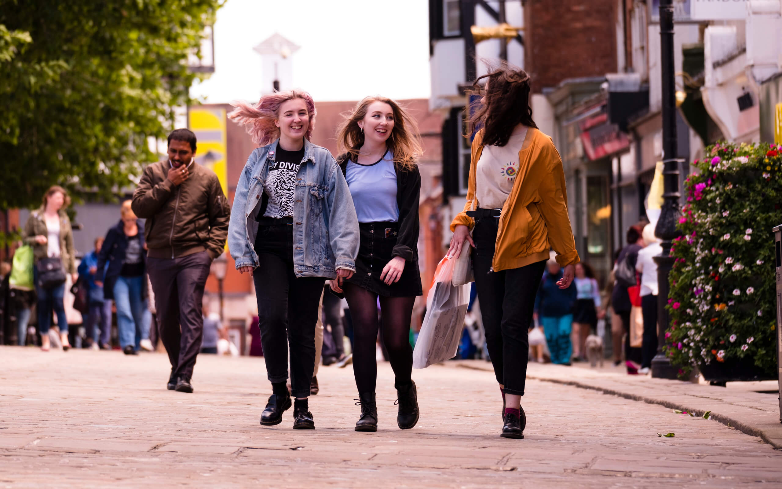 Three students walking through Chesterfield town centre.
