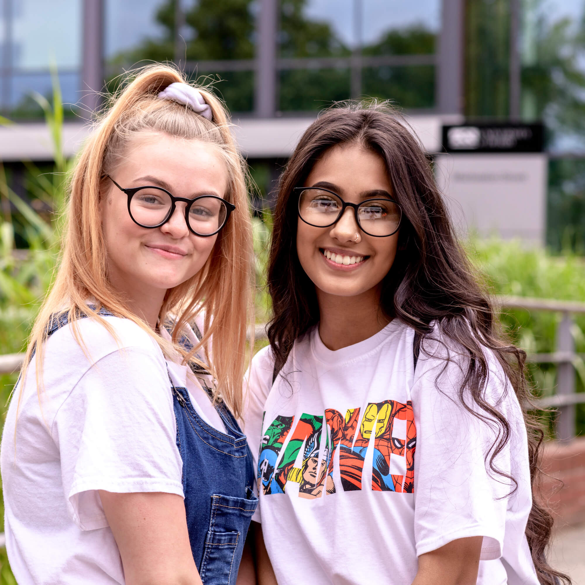 Two students outside Markeaton Street smiling