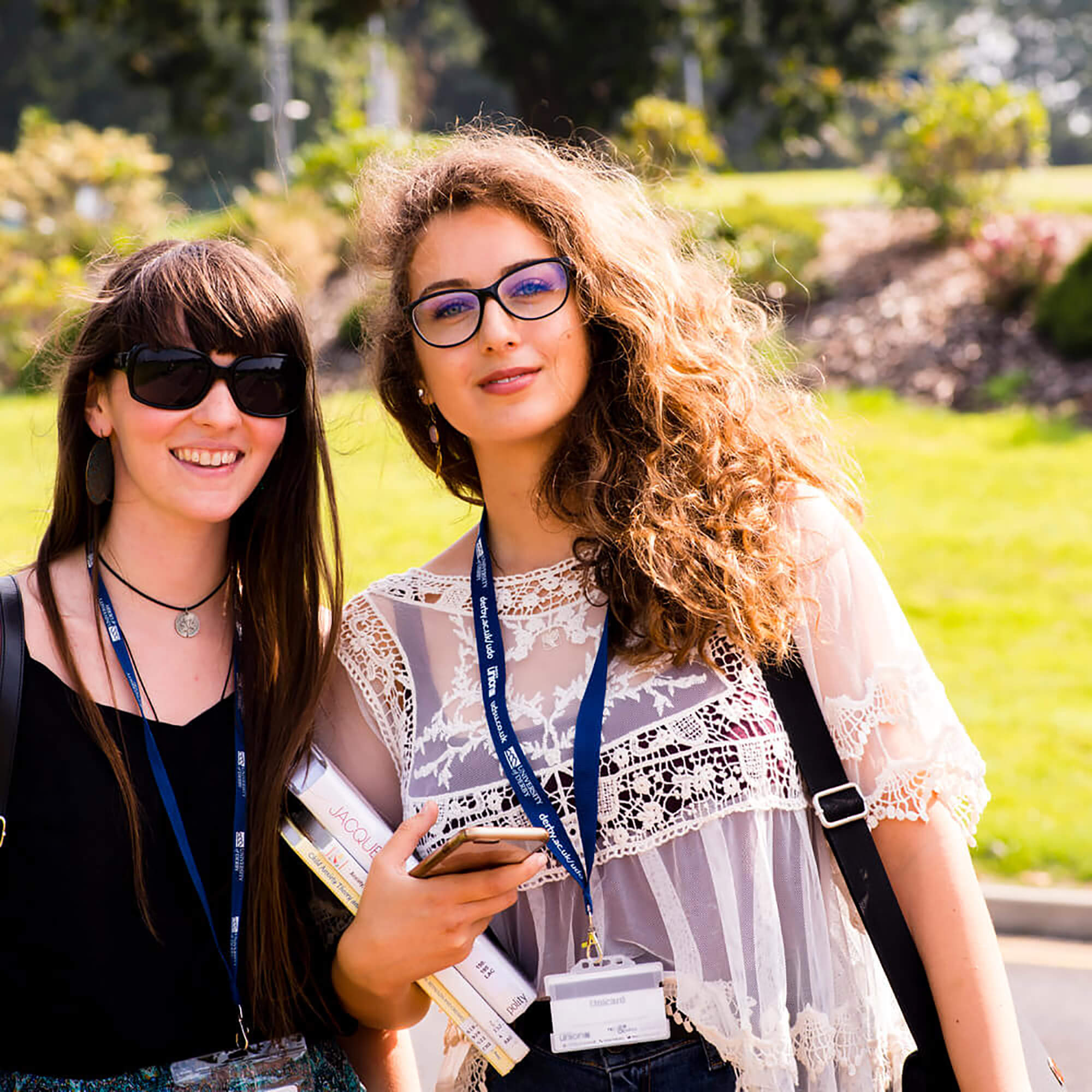 Two students standing outside the Kedleston Road Campus