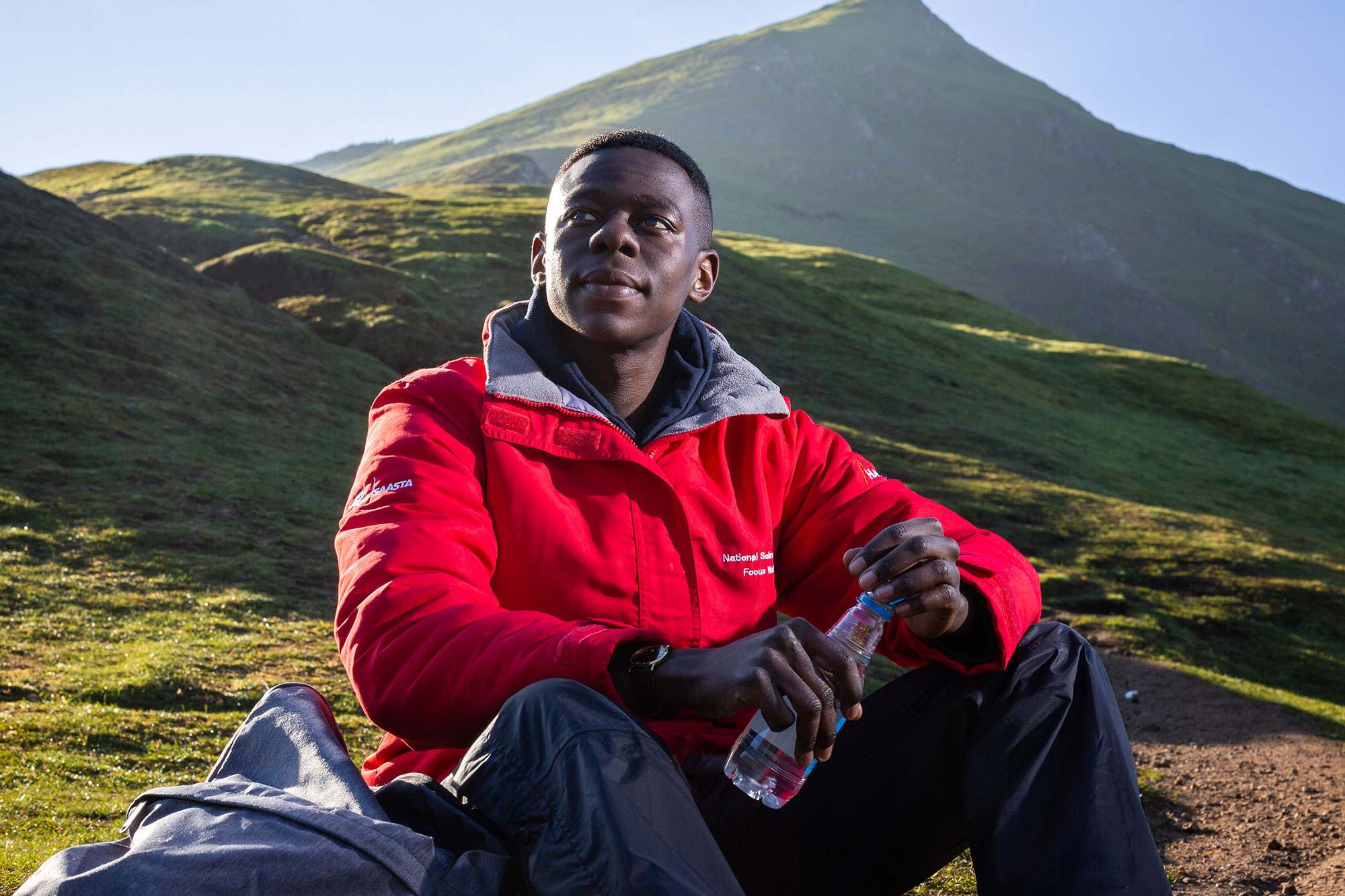 Student Sam sat on a hill during walk in Peak District