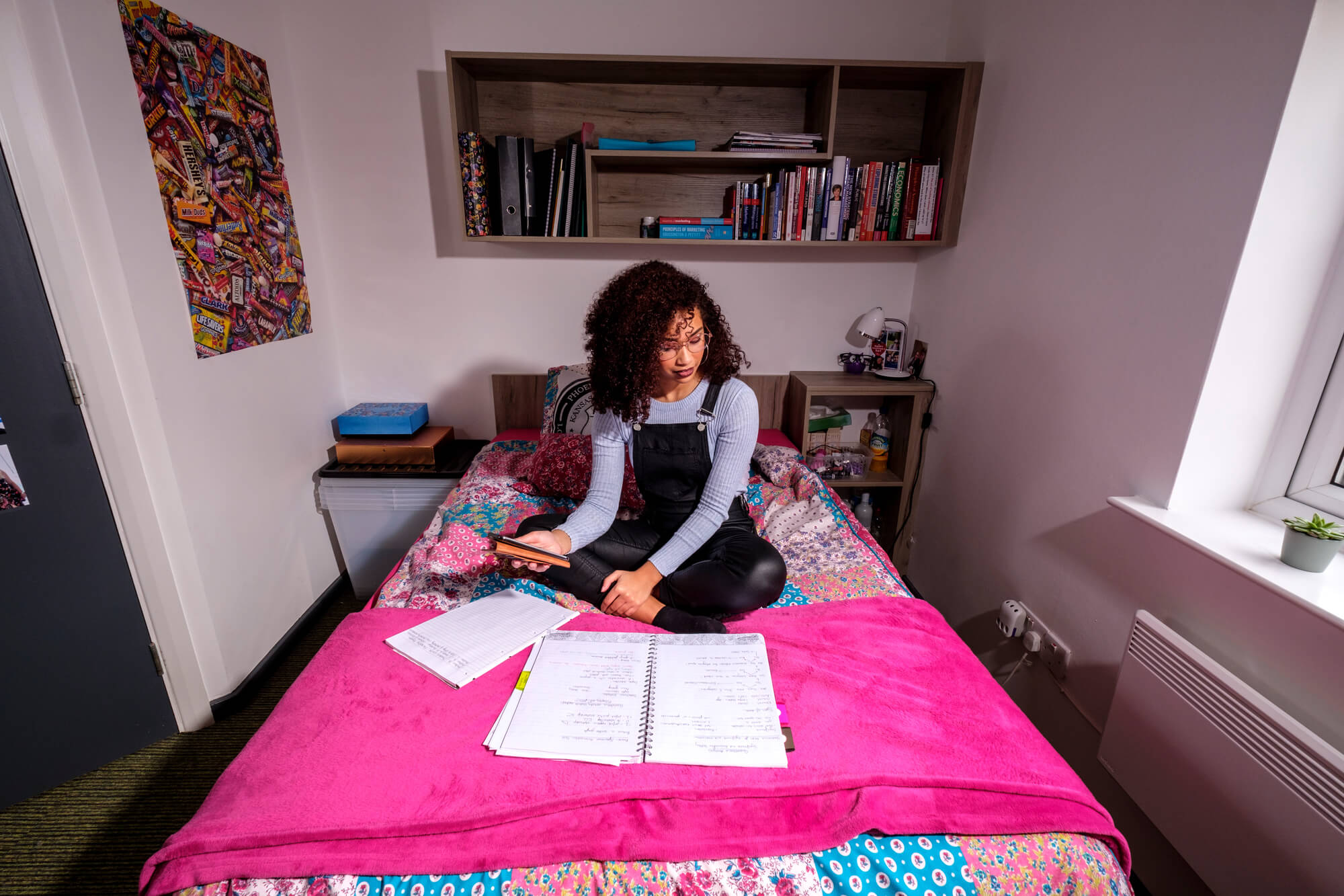 Student studying on bed in an En Suite Premium Bedroom at Nunnery Court halls
