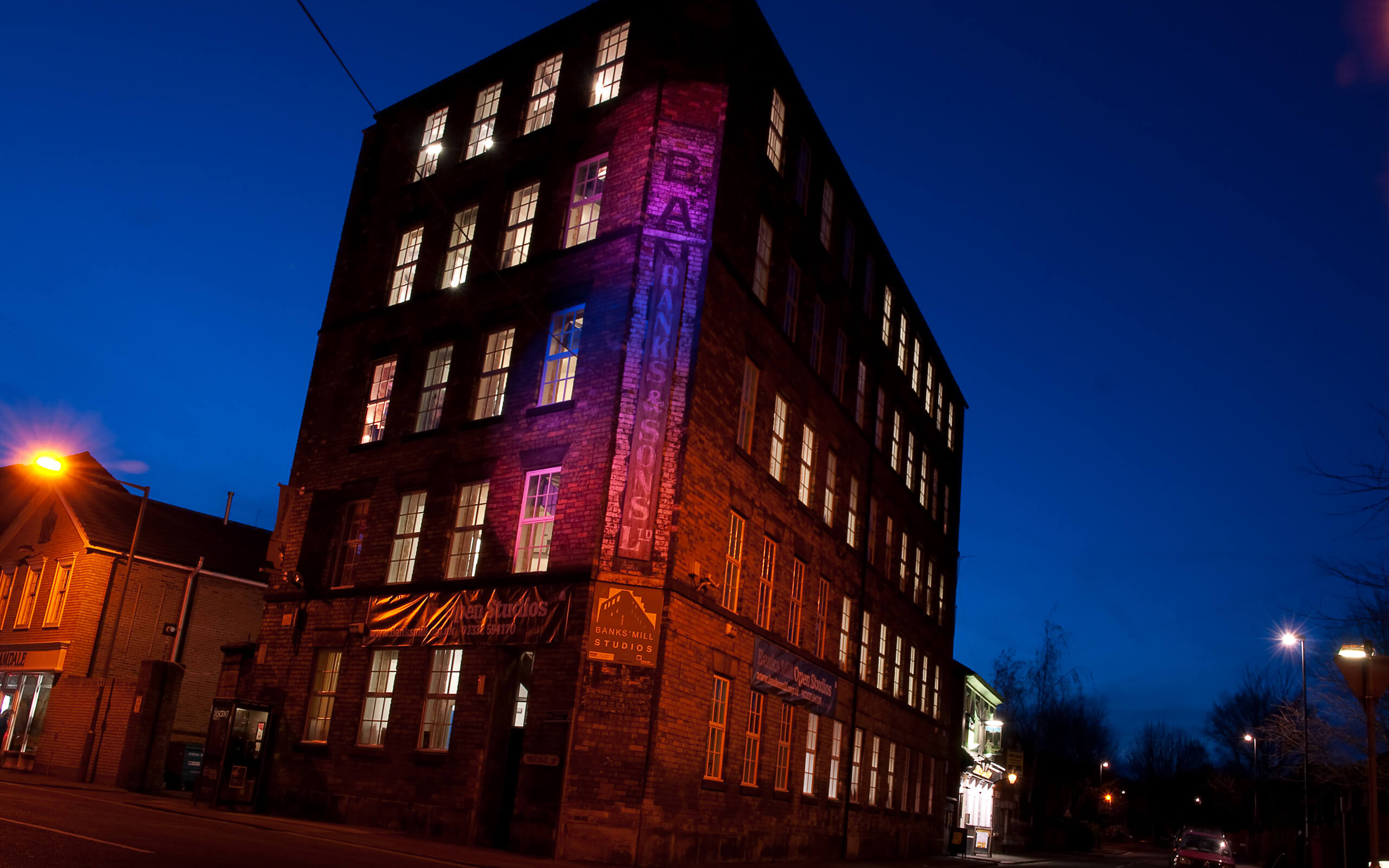 Banks Mill studios building, pink and blue colours shine through