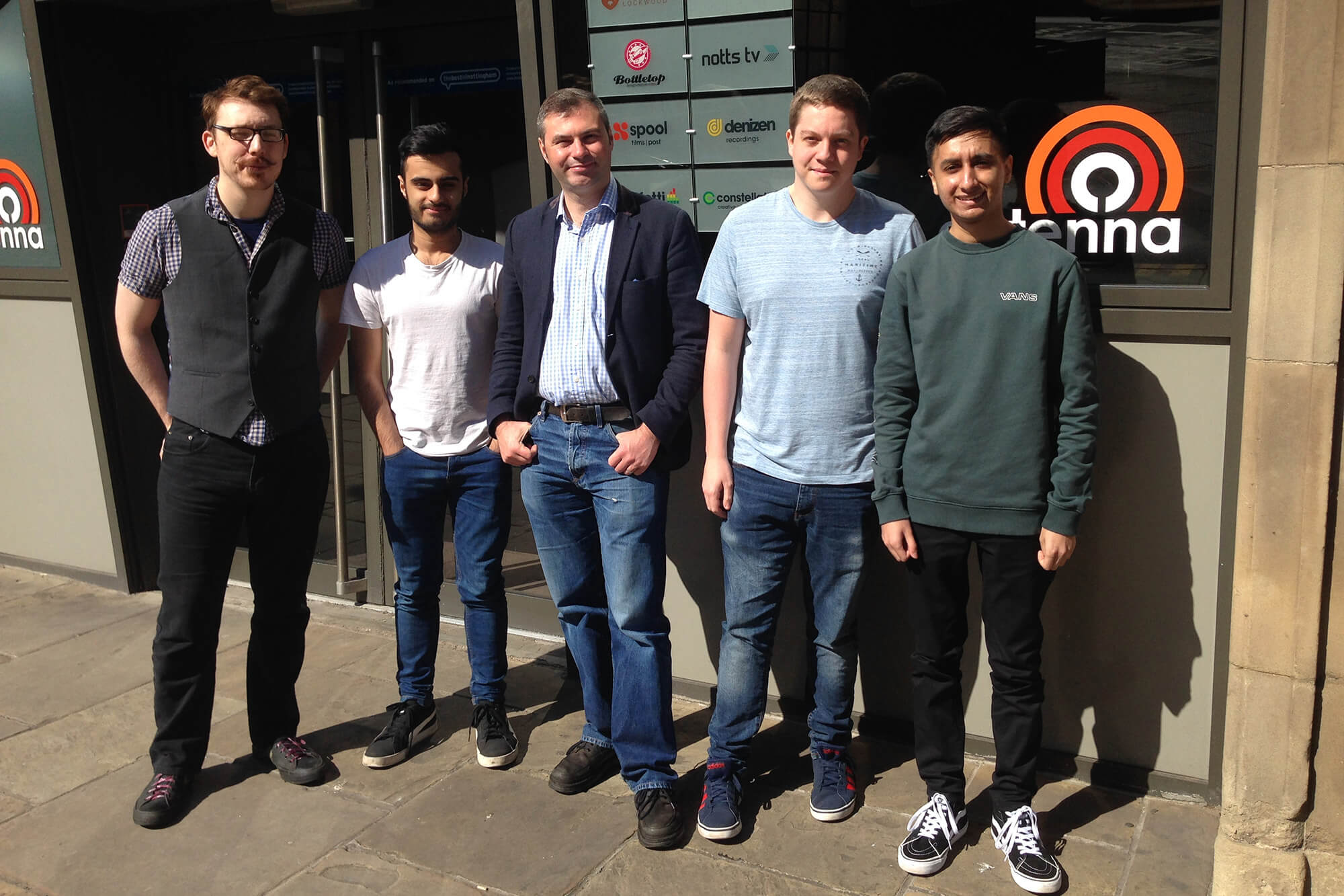 Legendary Games team standing outside their office in the sun