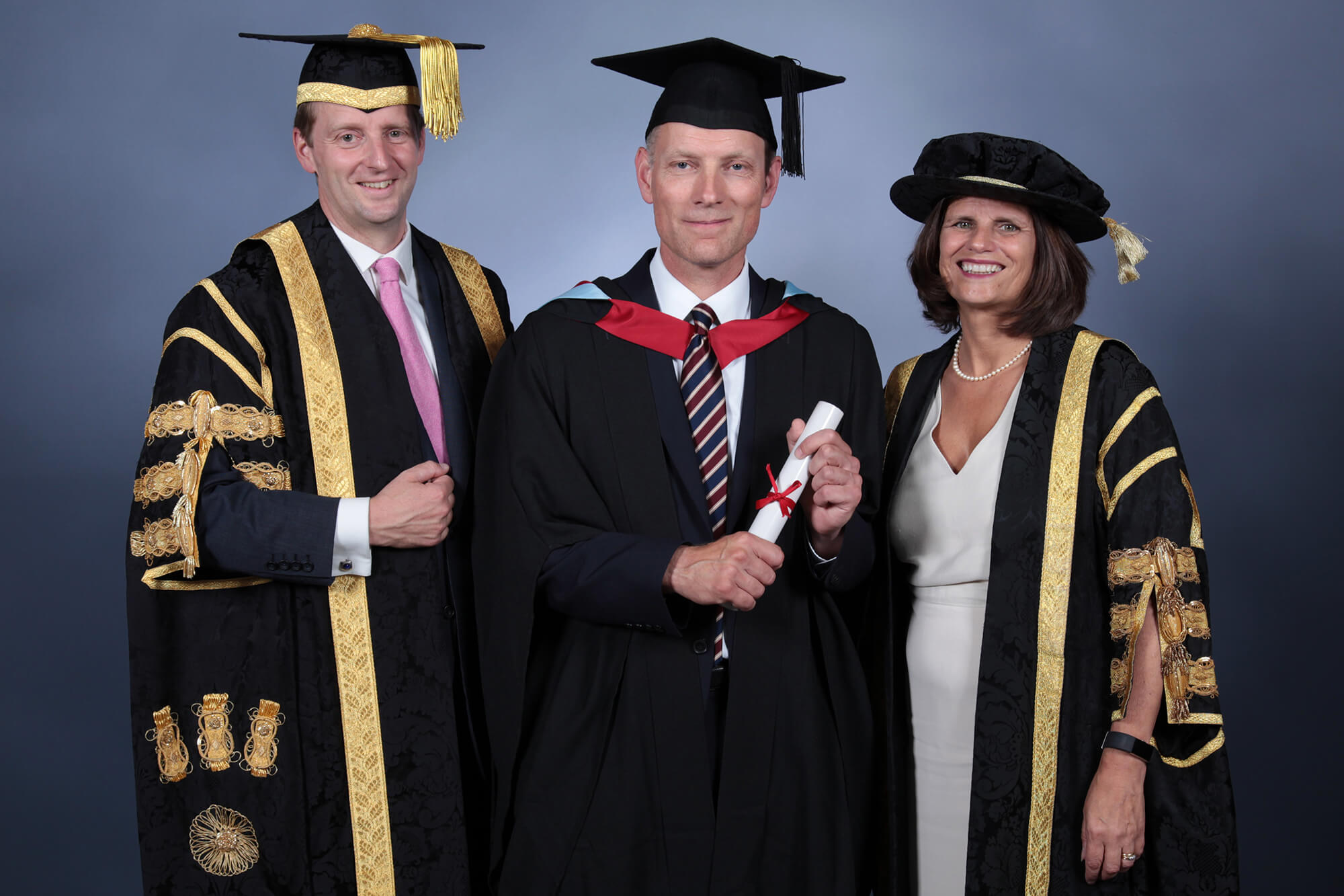 Robin Gillespie graduation photo with Vice Chancellor Kath Mitchell