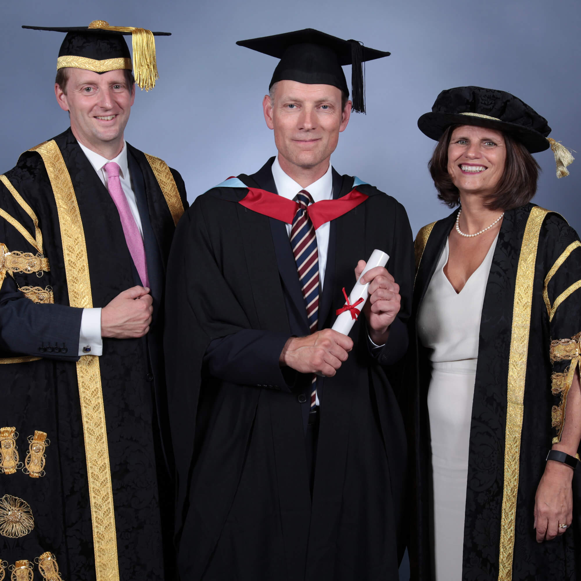 Robin Gillespie graduation photo with Vice Chancellor Kath Mitchell and Chancellor