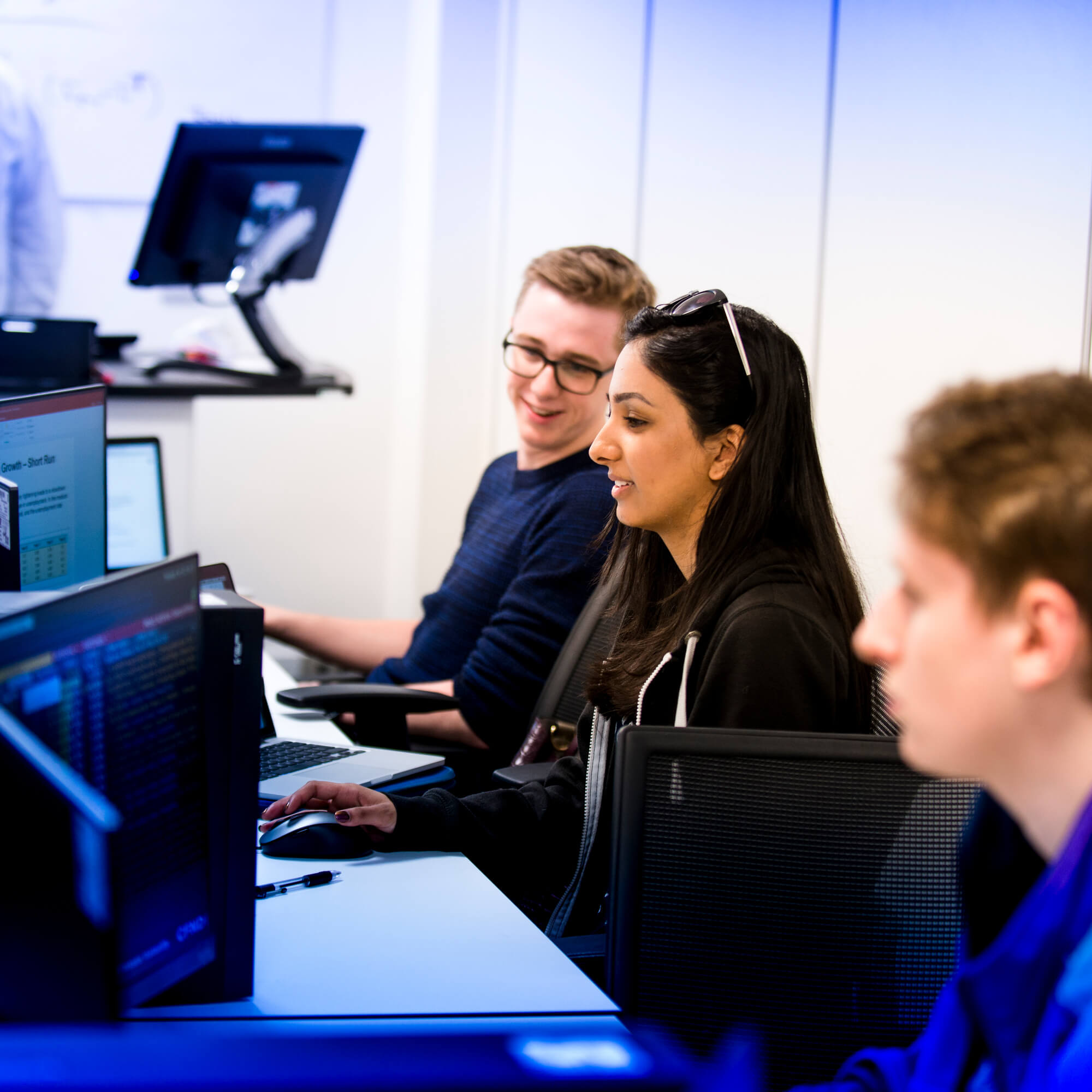 Students working at computers in the University's Bloomberg Suite