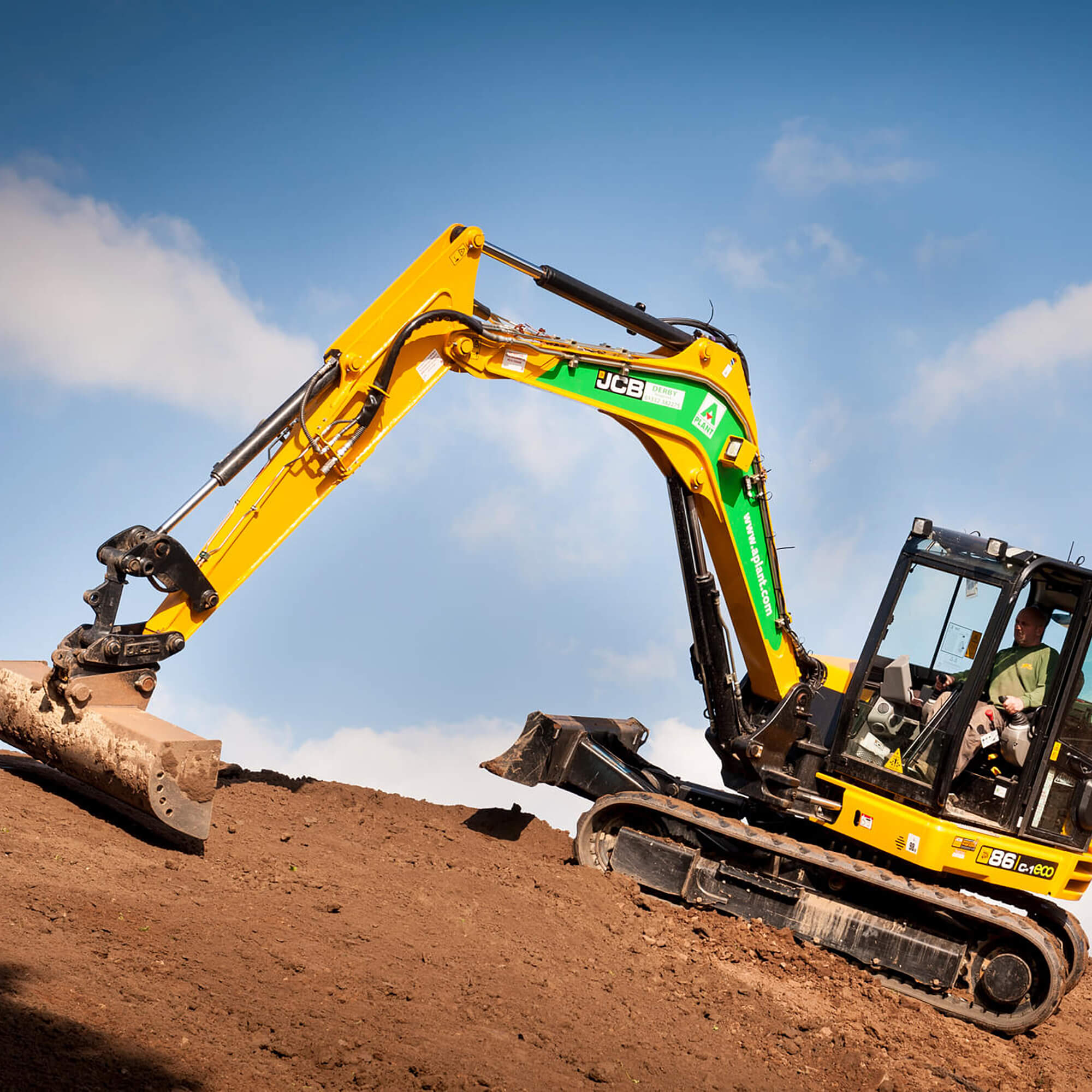 Picture of a man operating a digger