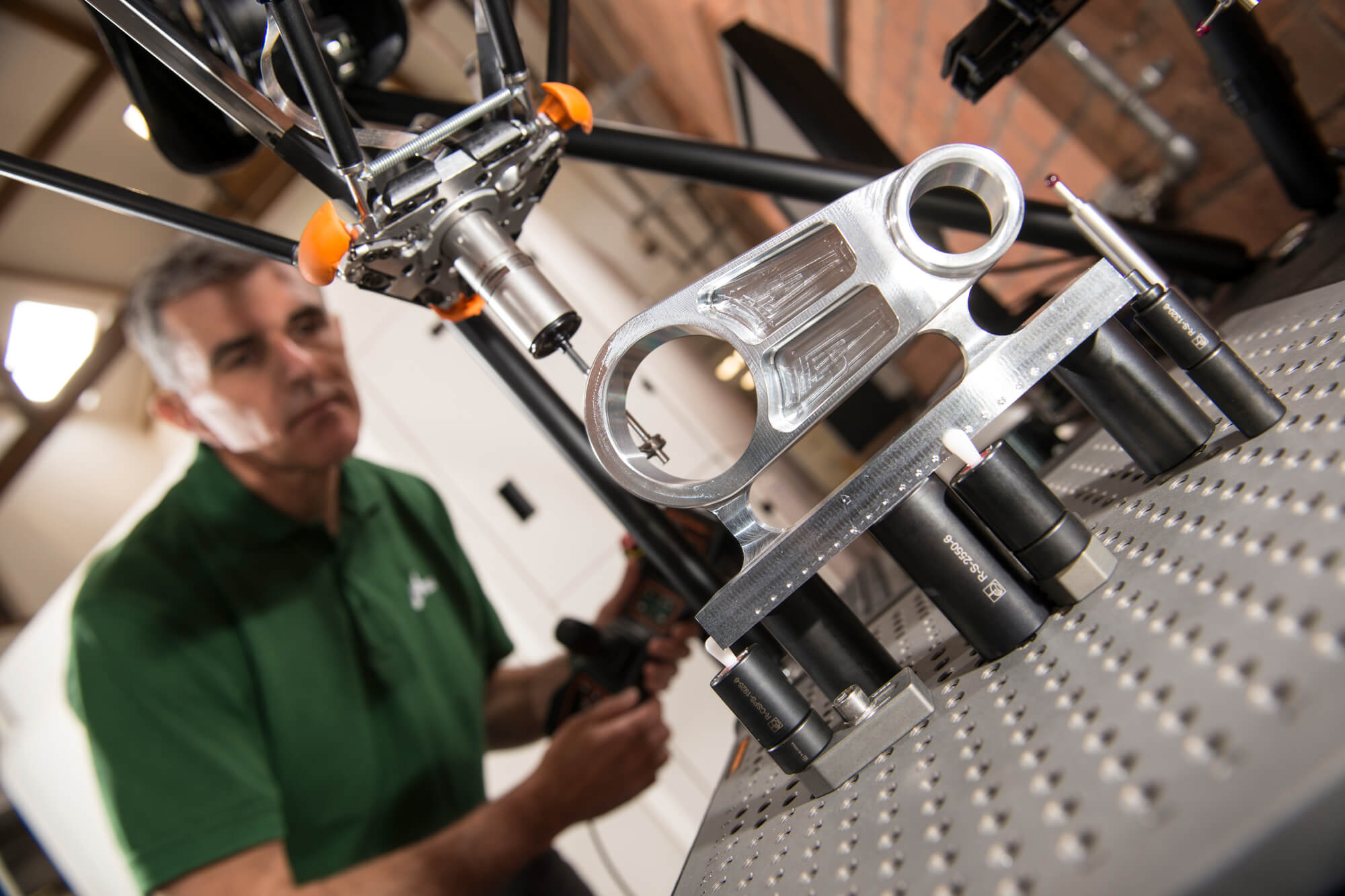 Man working on machinery in the Institute for Innovation in Sustainable Engineering
