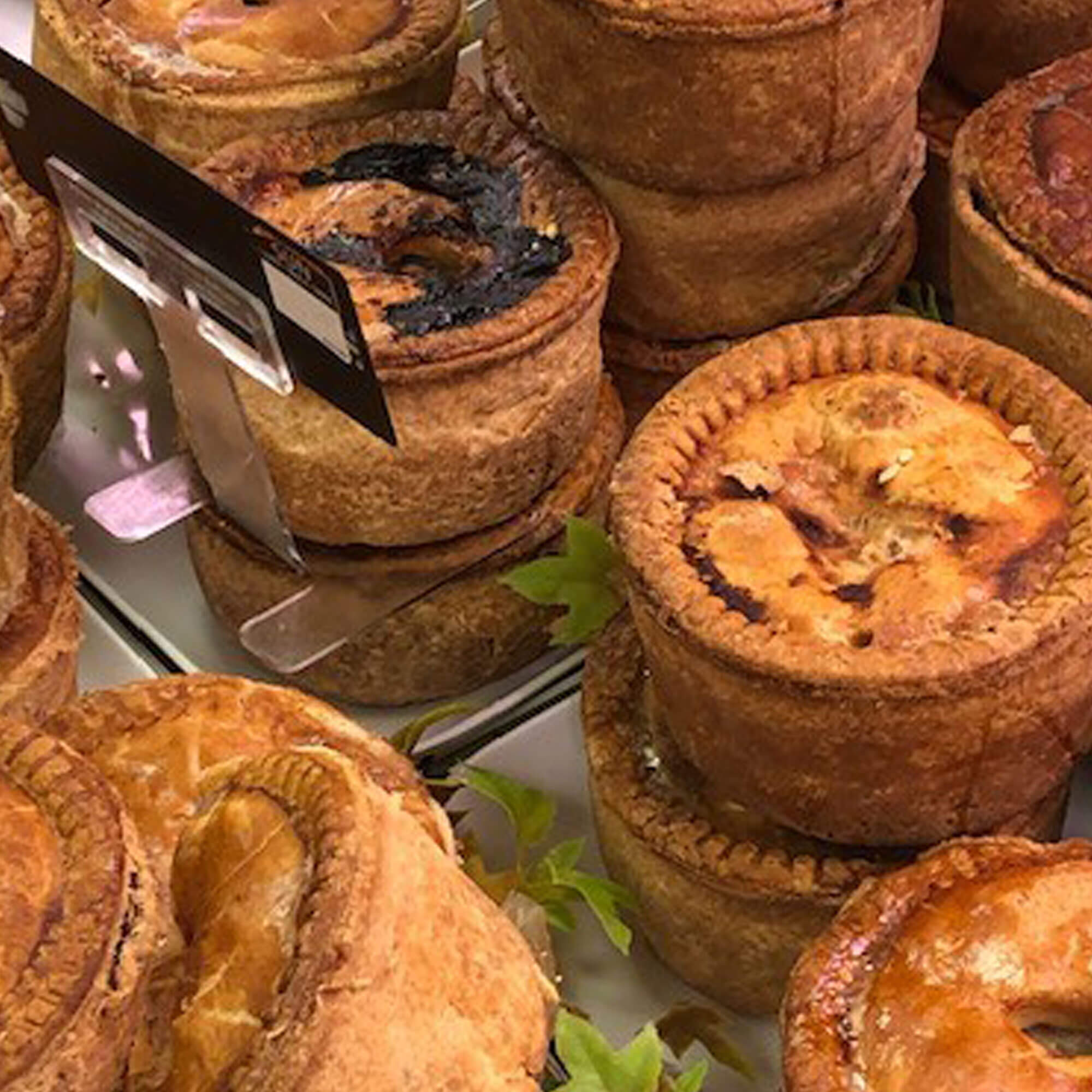 A selection or pork pies laying in the fridge