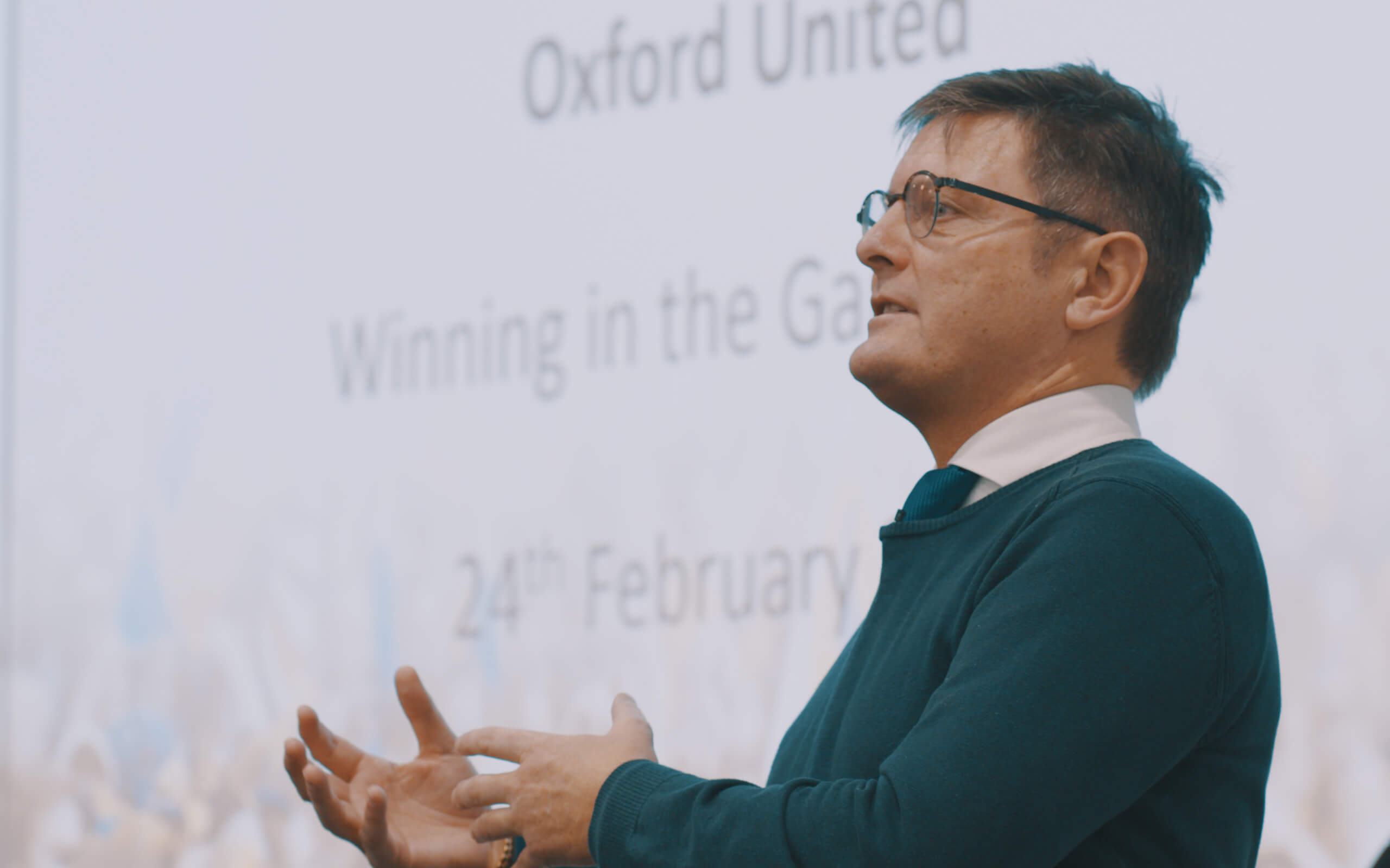 Lecturer in front of powerpoint