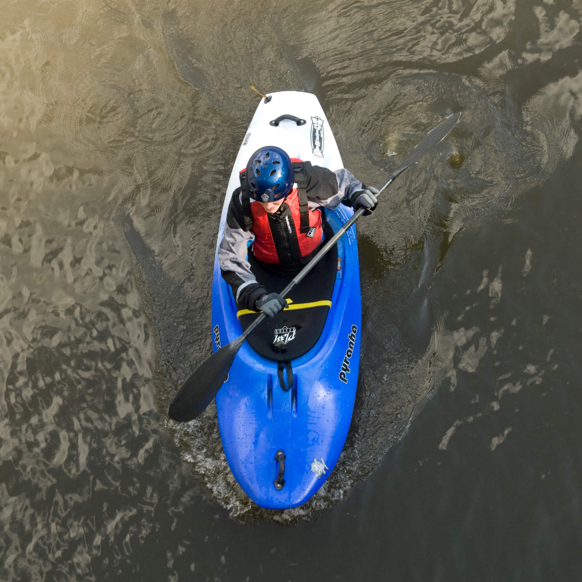 A man in a blue canoe in the canal
