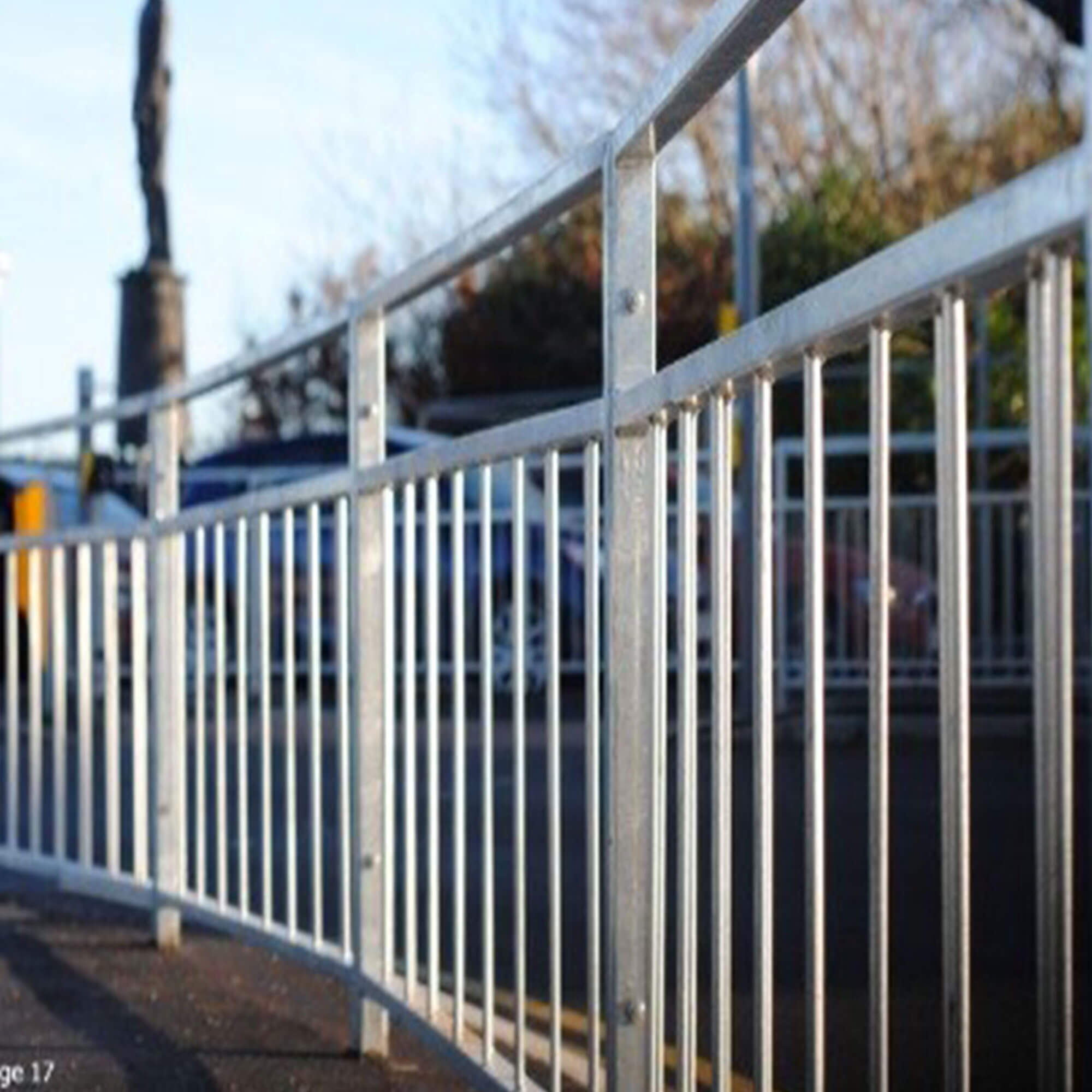 A image of a handrail that you would get beside a road crossing