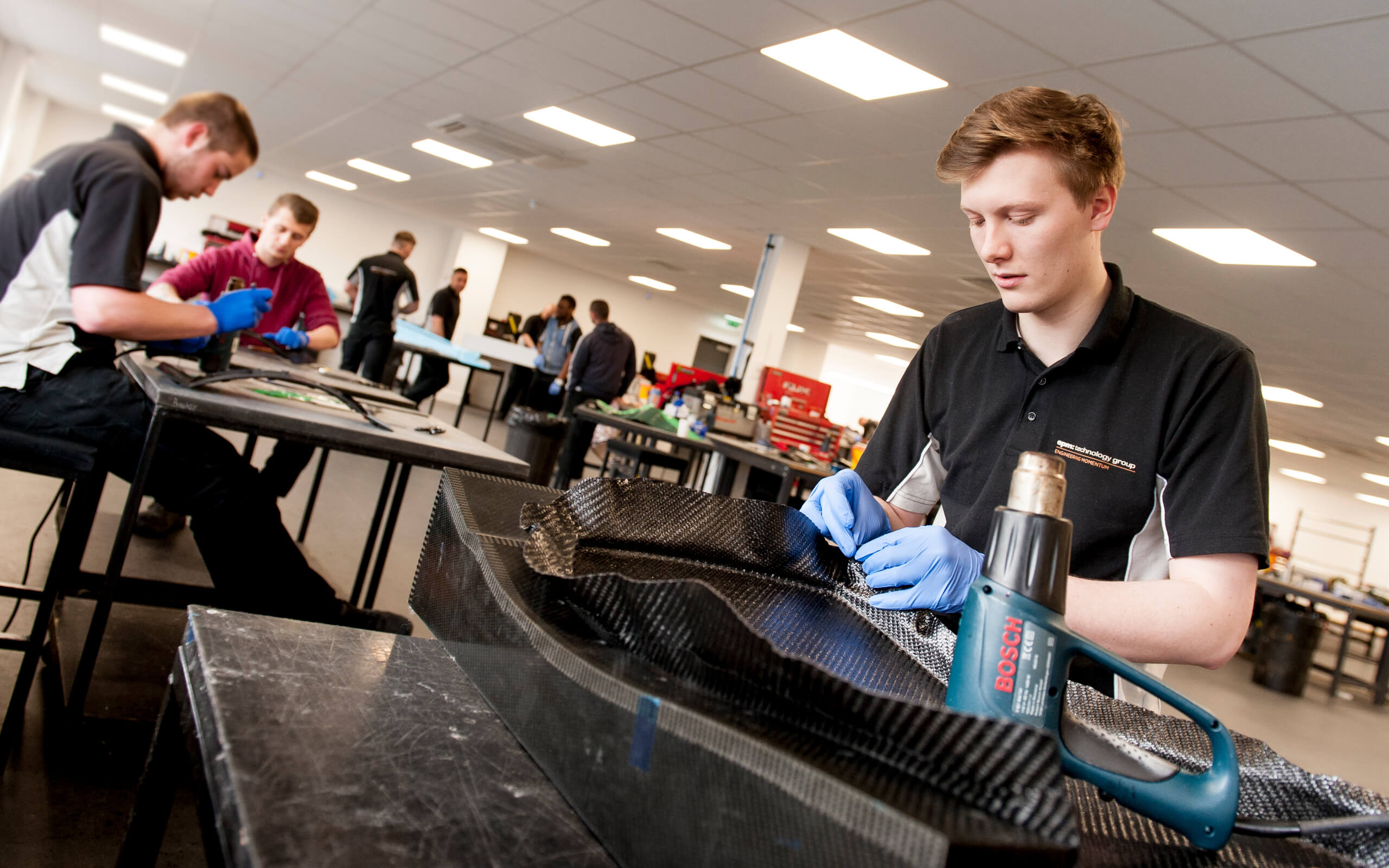 Young male working in a manufacturing environment