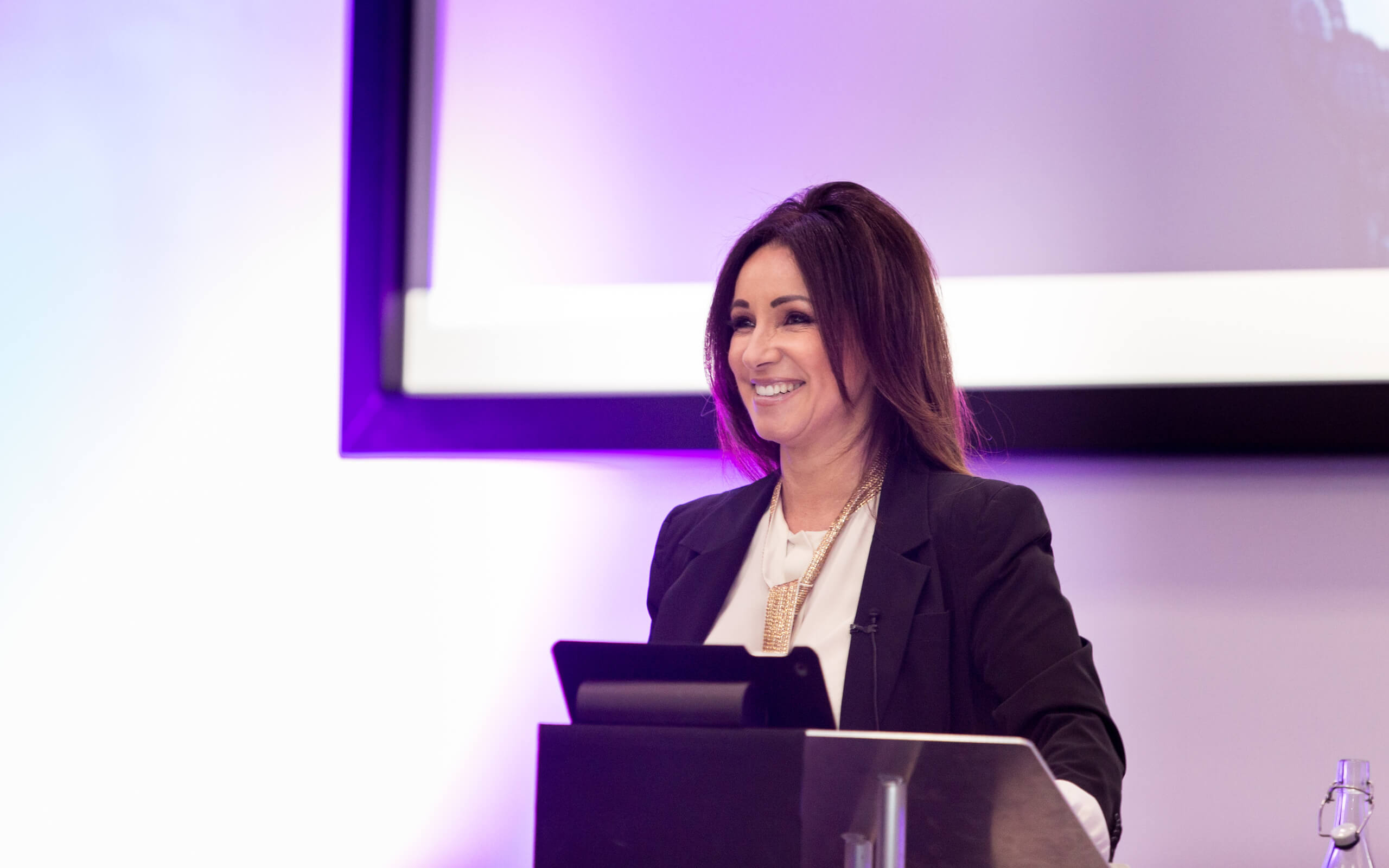 Female speaker at an event