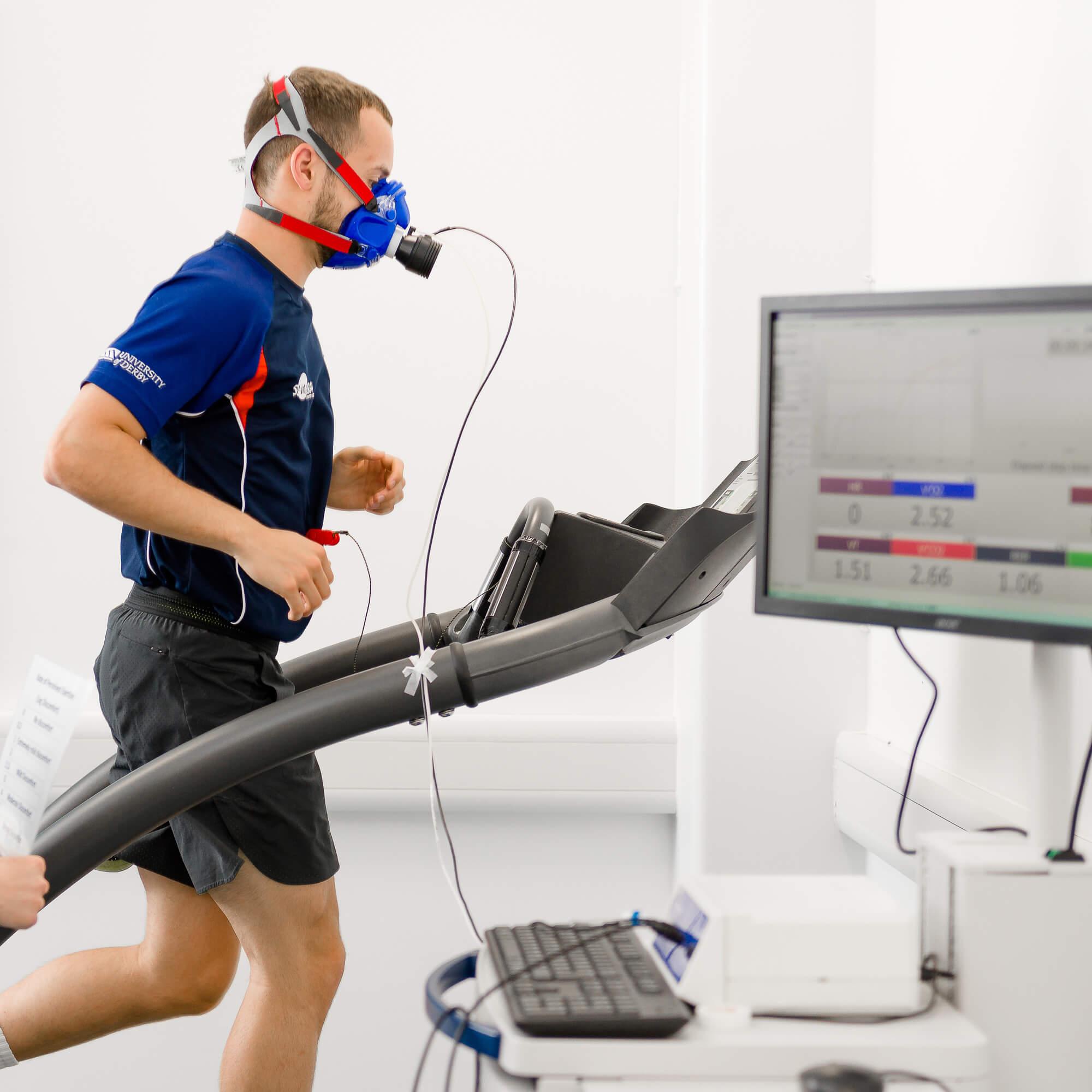Athlete undergoing VO2 max test on treadmill