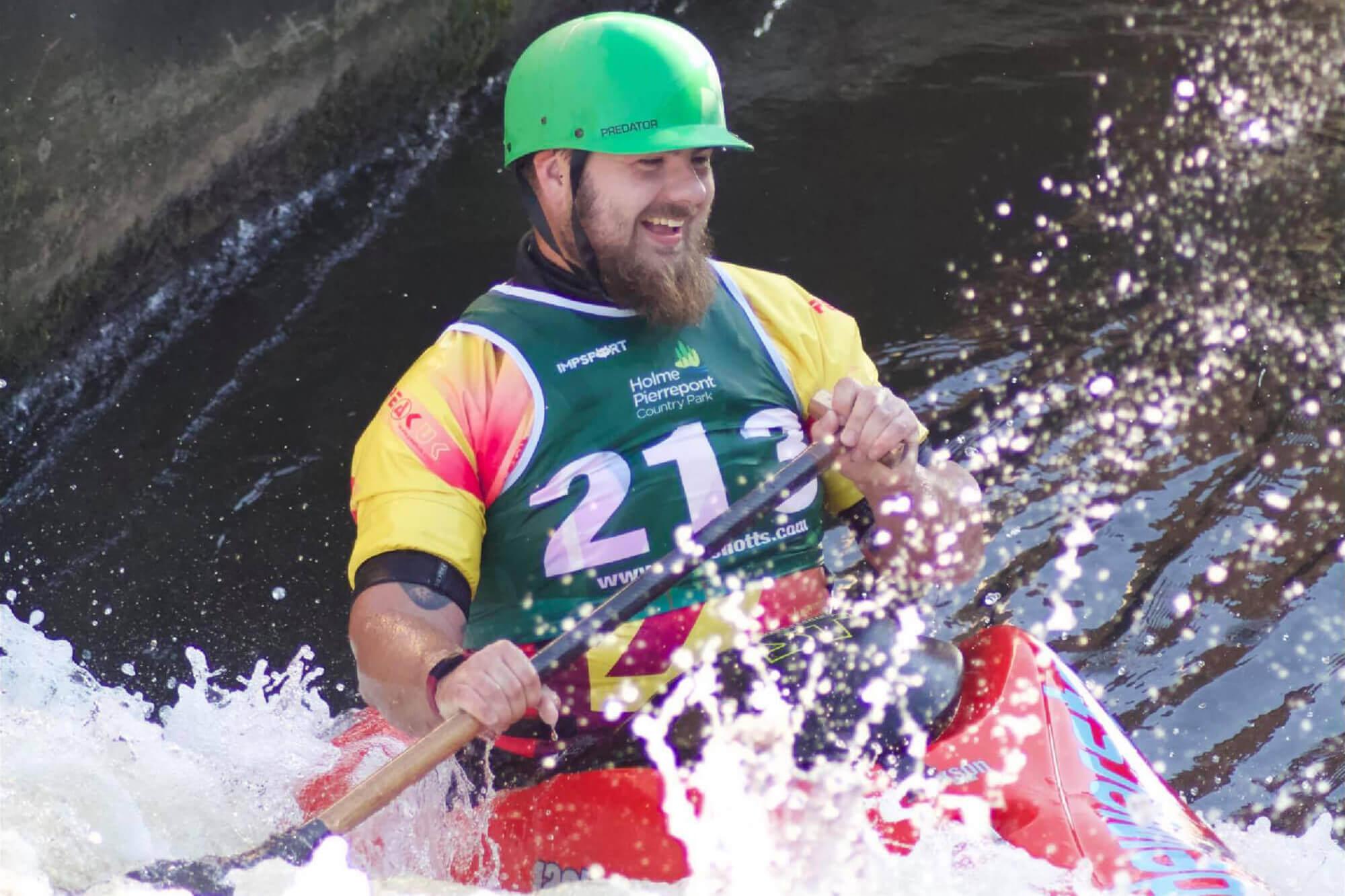 James kayaking surrounded by crashing waves