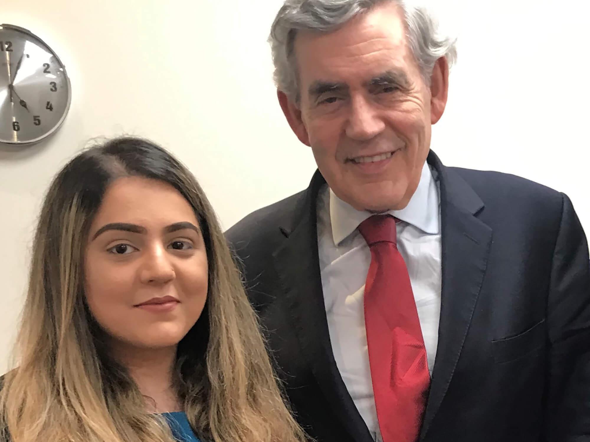 Ikra Yasin stood with Gordon Brown