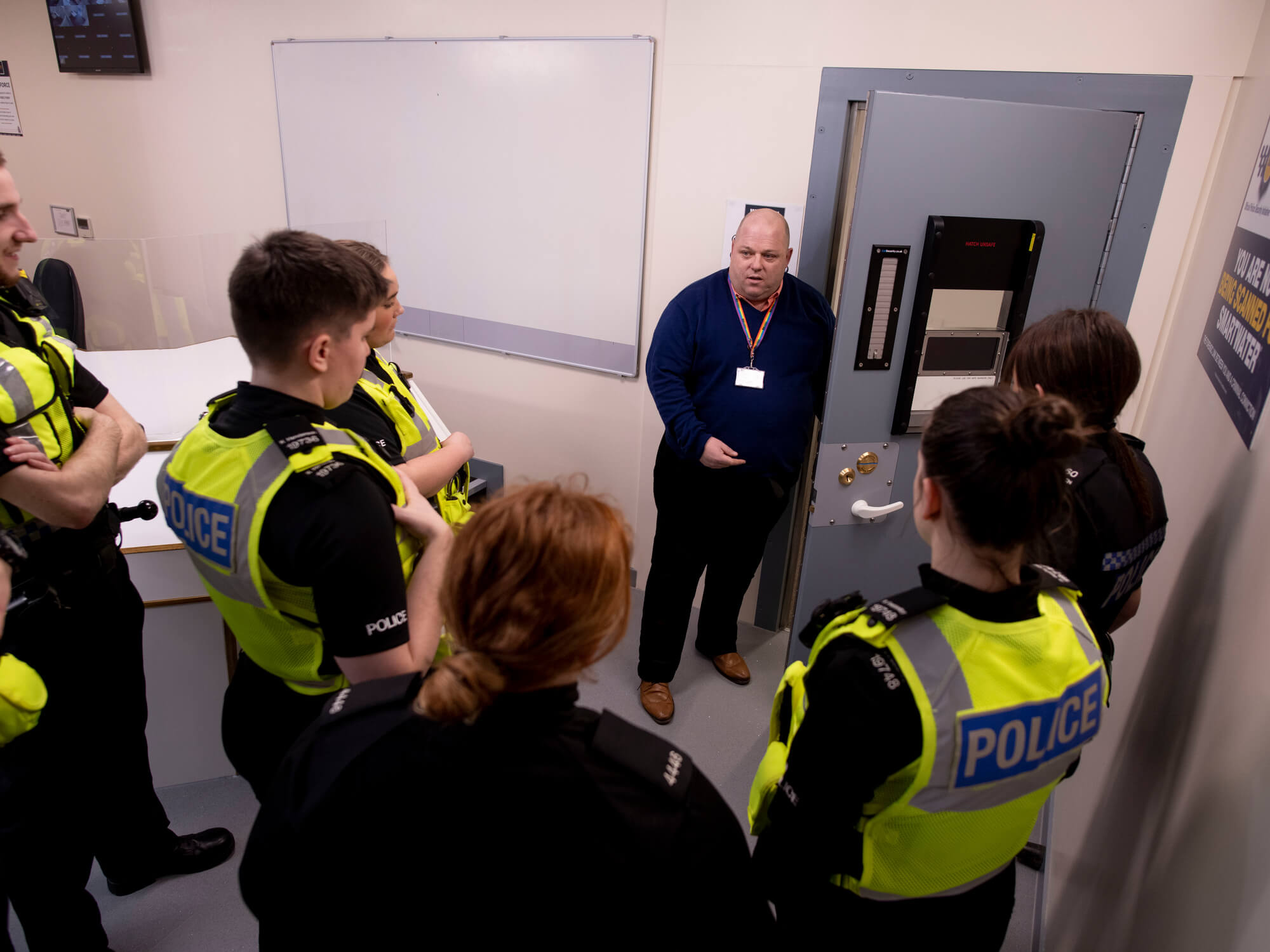 Policing students in uniform learning how to operate cell door
