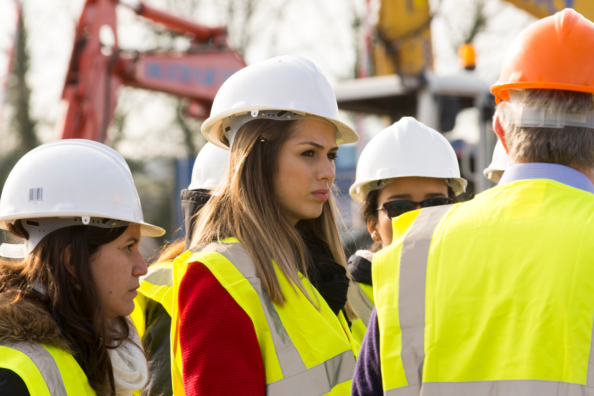 Students on a field trip at a building site