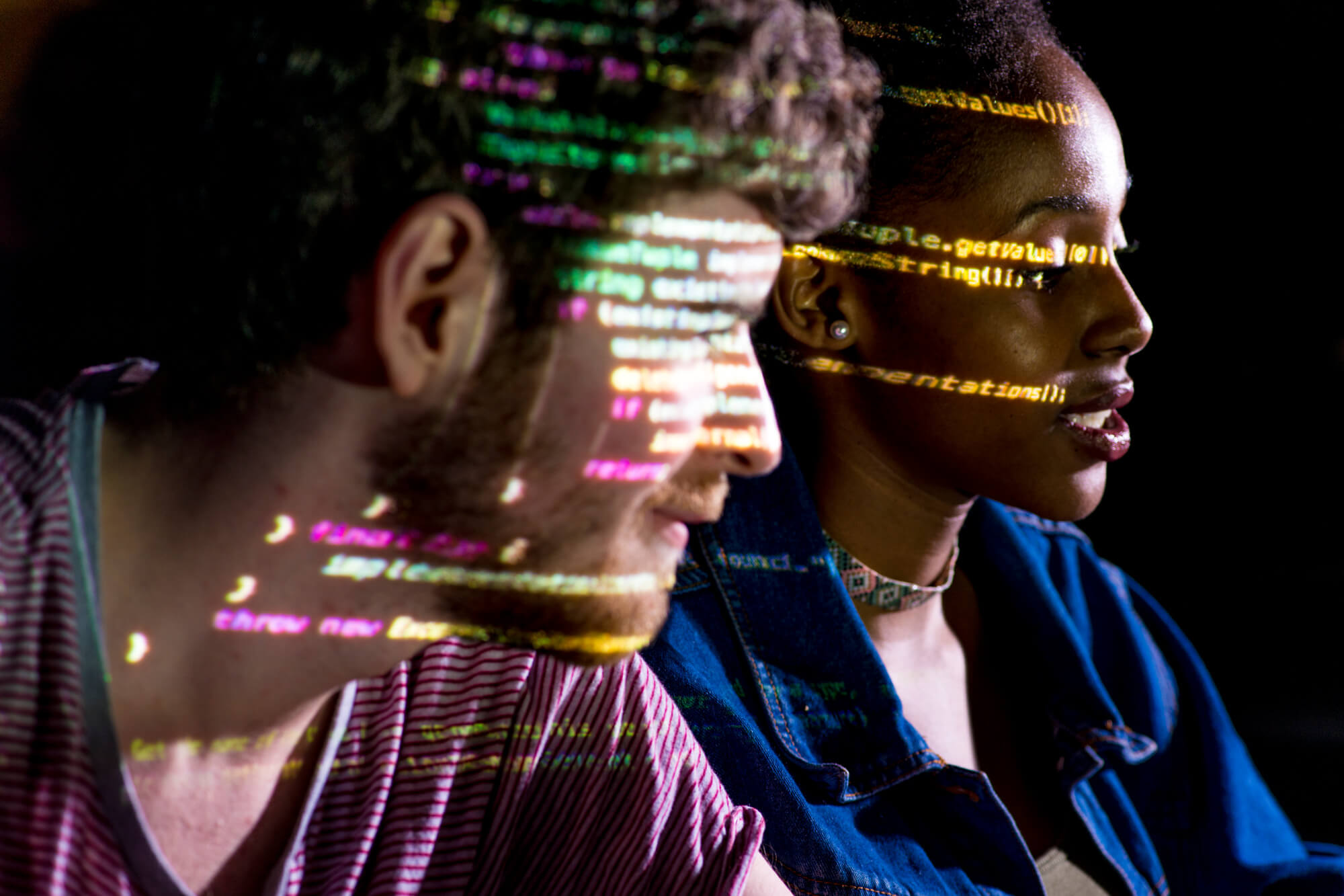 Computing code reflected on students faces