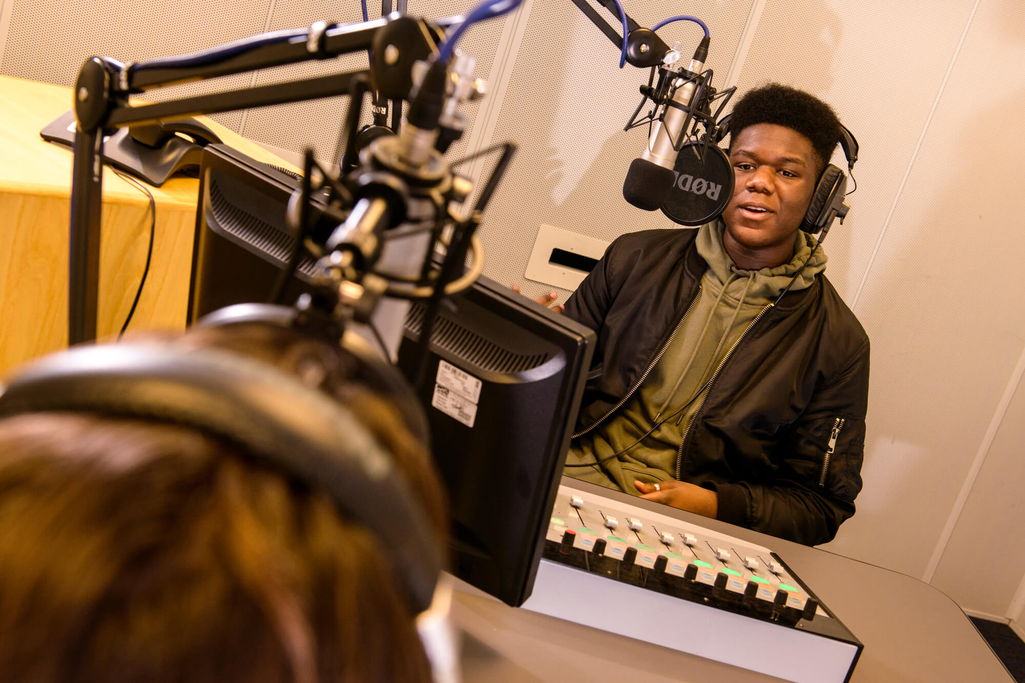 A student in the radio production studio
