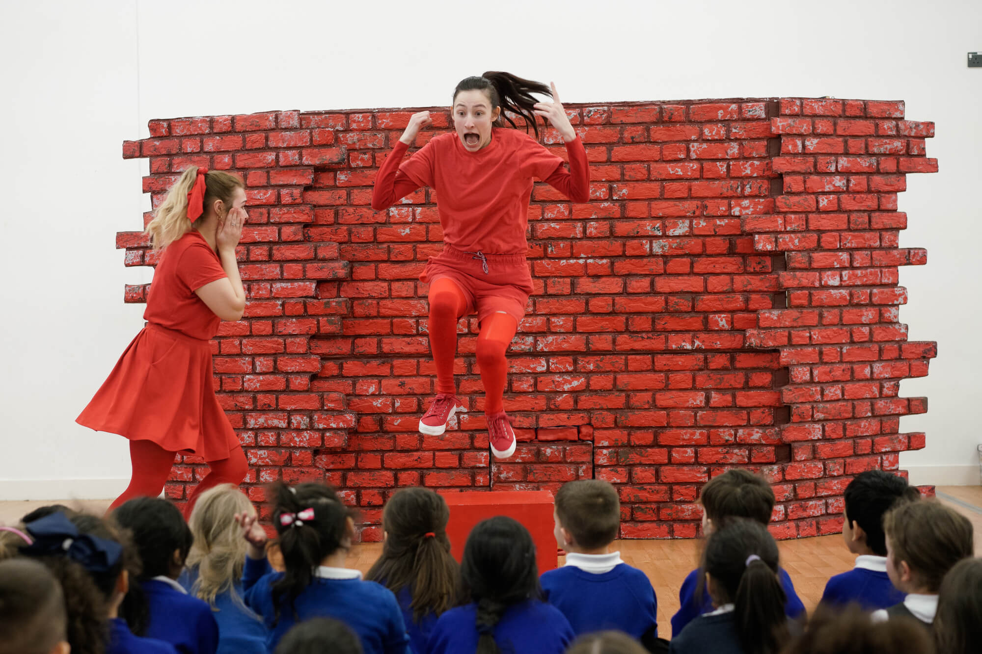 Applied Theatre and Education students taking part in a performance for a group of school children