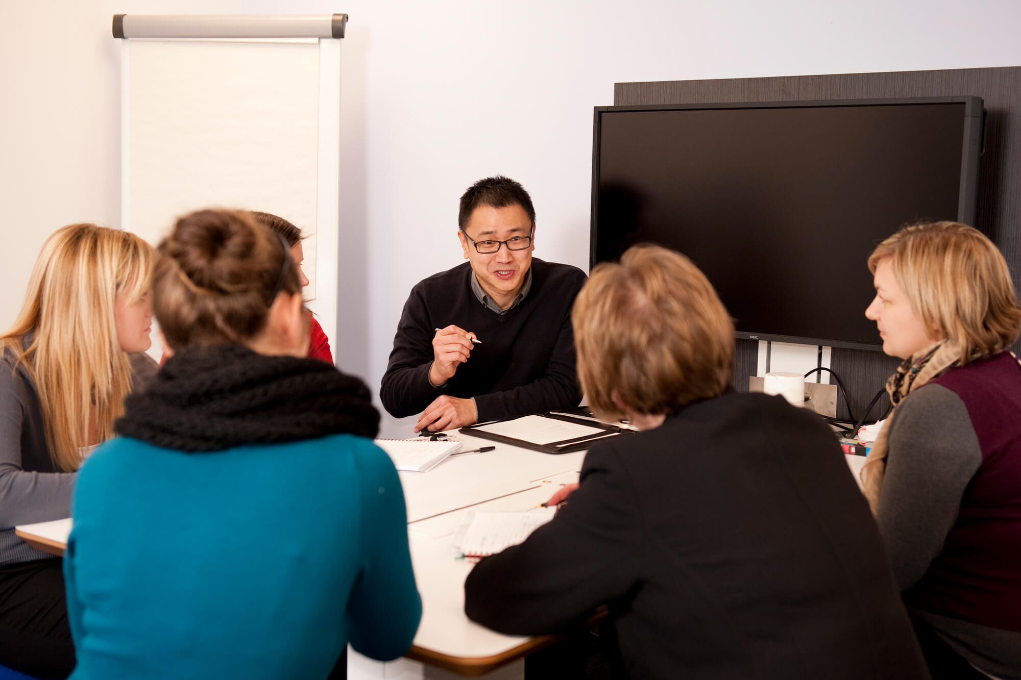 postgraduates discussing ideas at an event