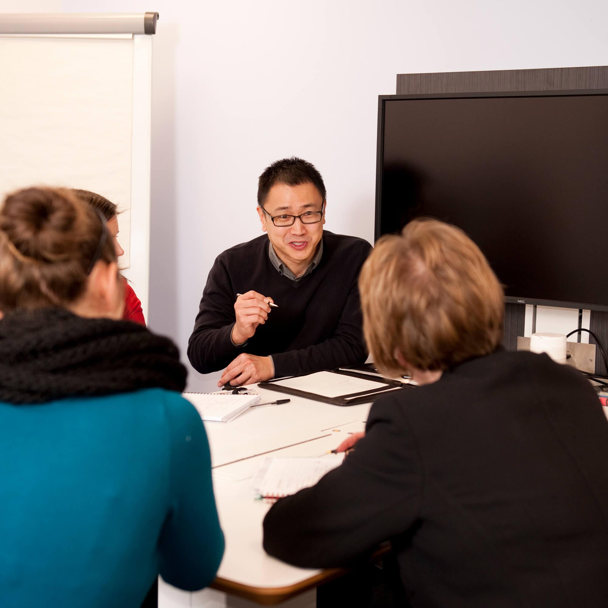 Academics meeting at the Enterprise Centre
