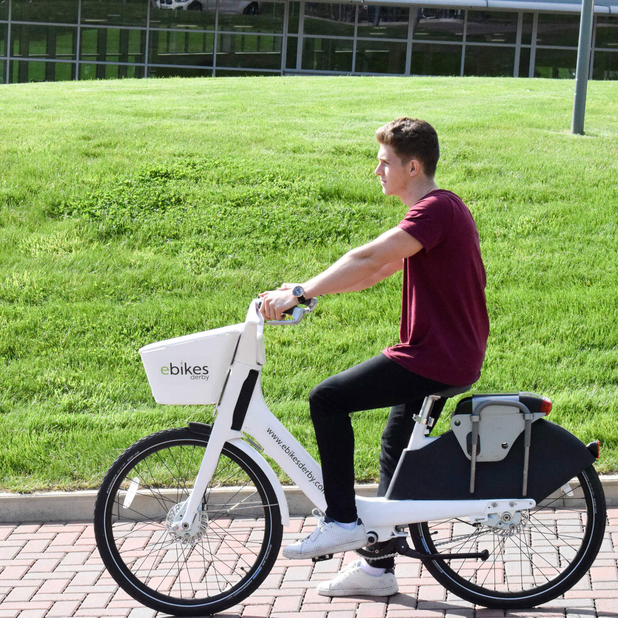 A student on an ebike on campus