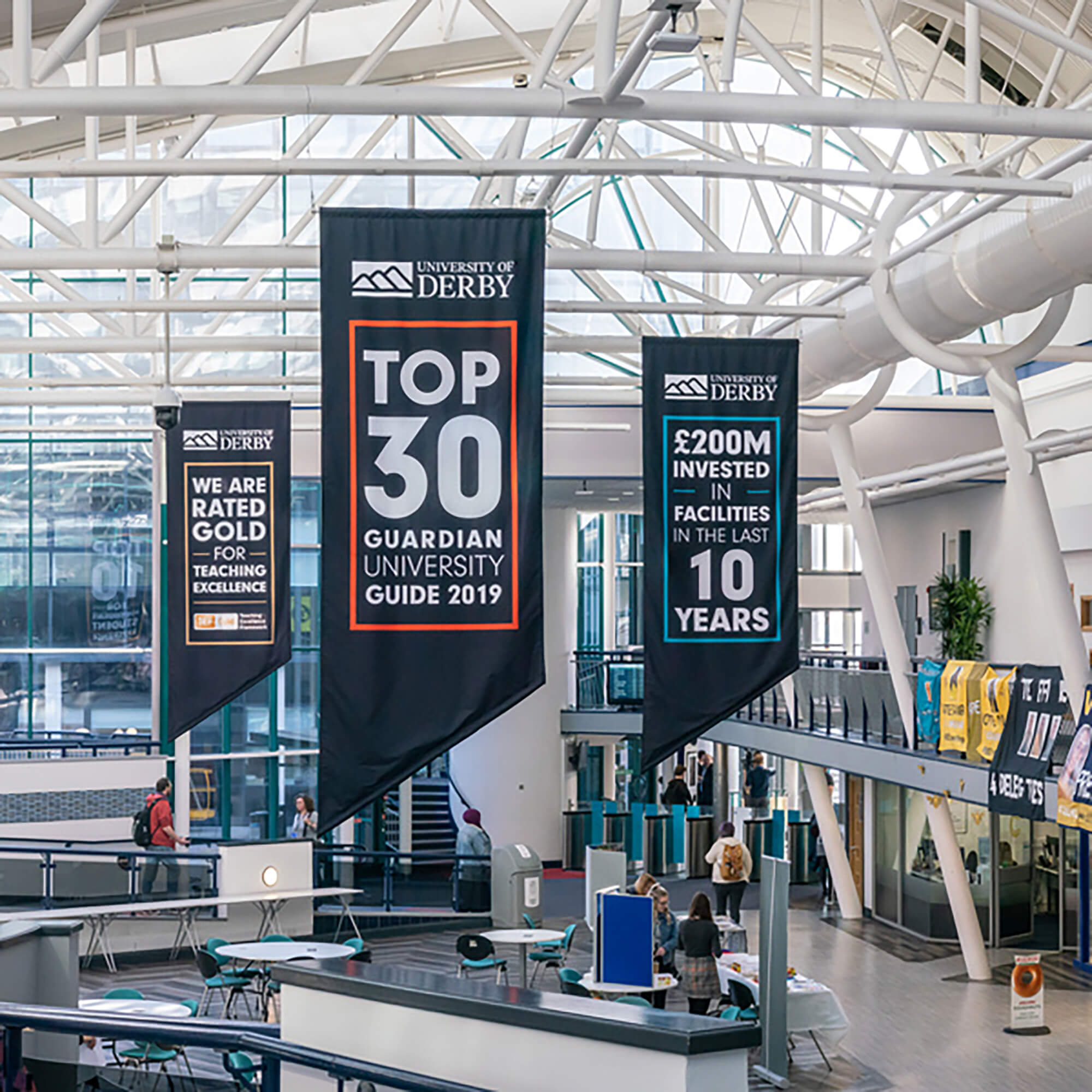 University statistic banners hanging from ceiling in the Atrium at Kedleston Road