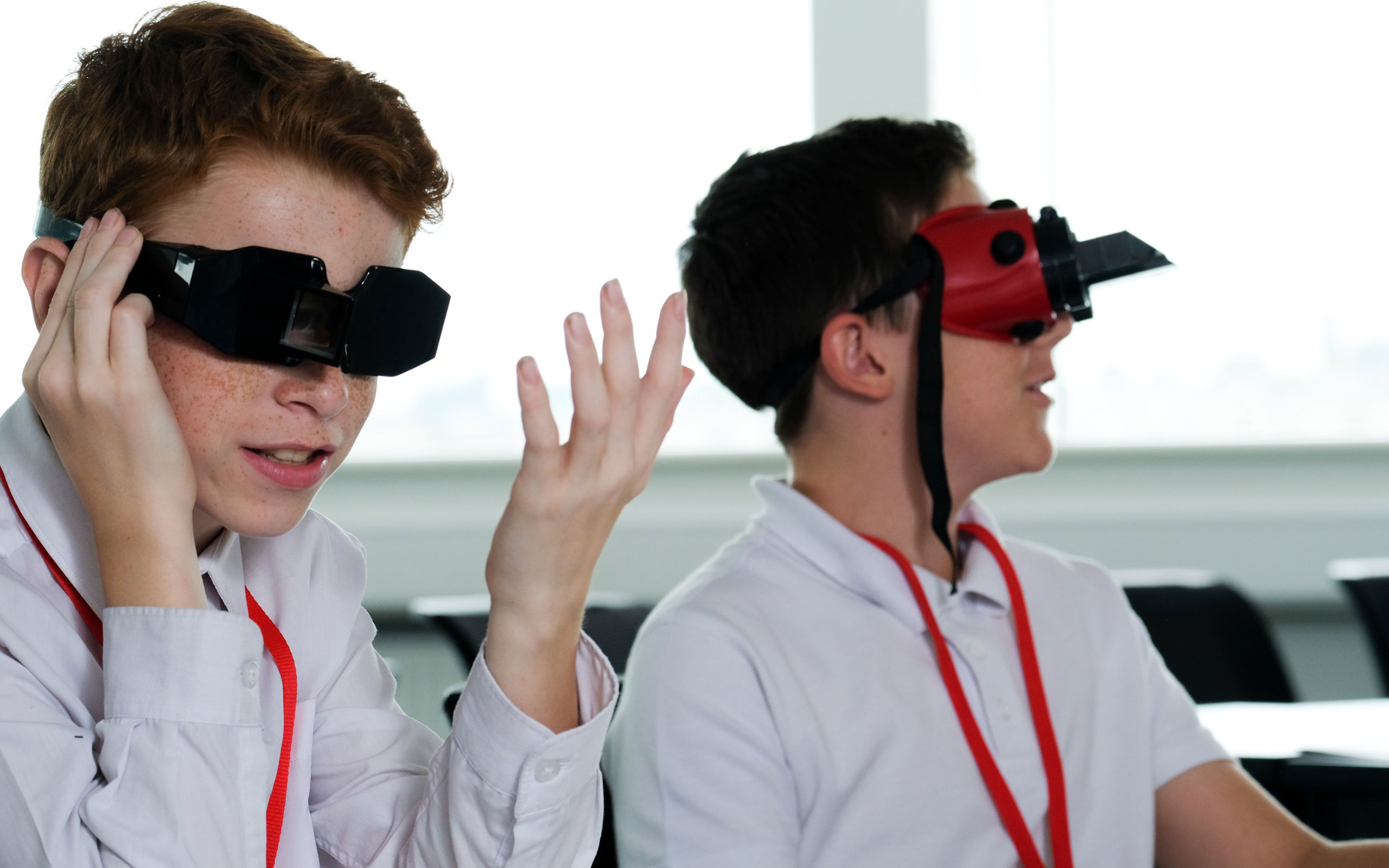 Two students wearing reversing goggles