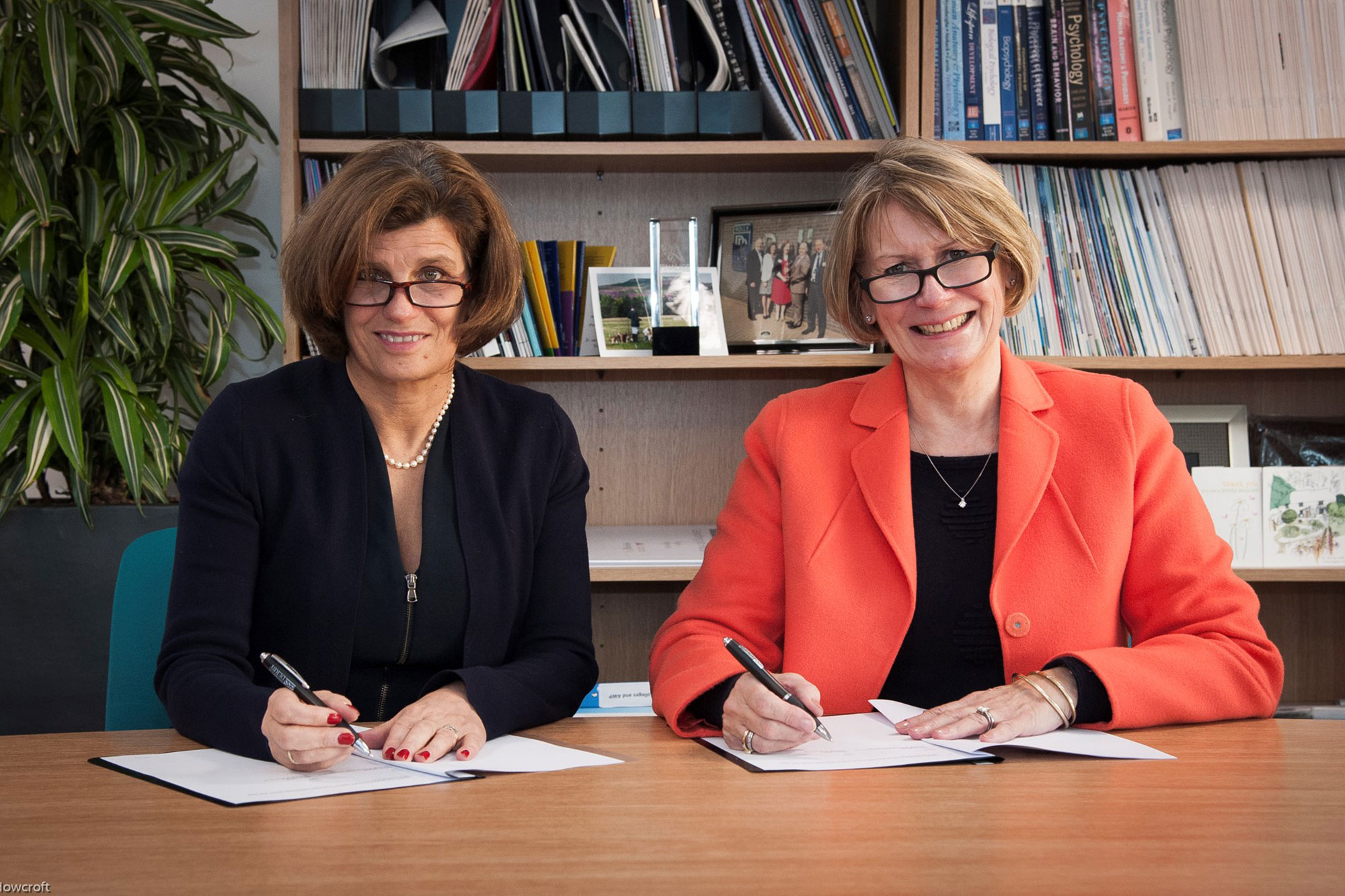 Professor Kathryn Mitchell and Advance HE CEO Alison Johns sign the memorandum of understanding