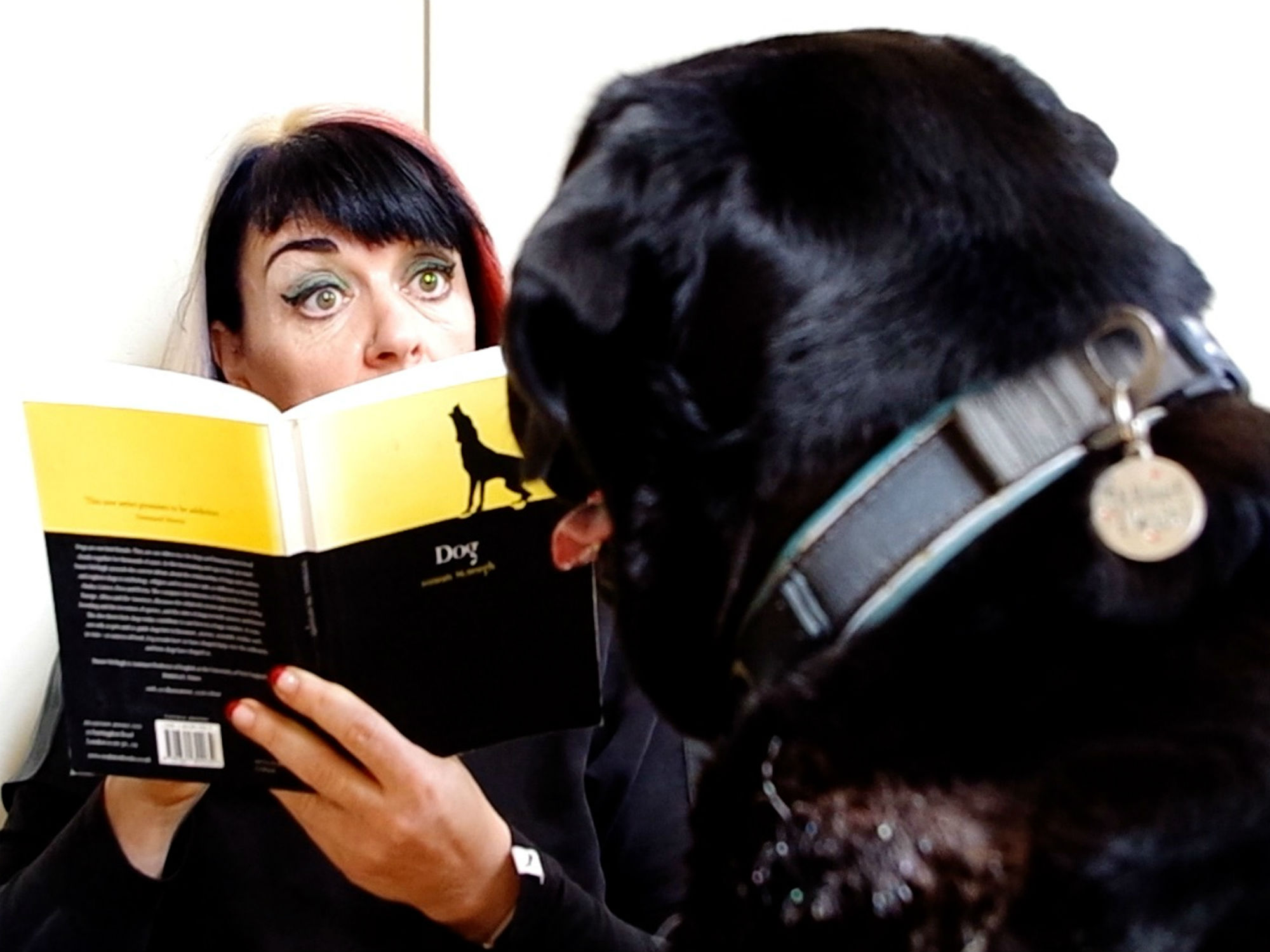 Angela Bartram reads book to dog