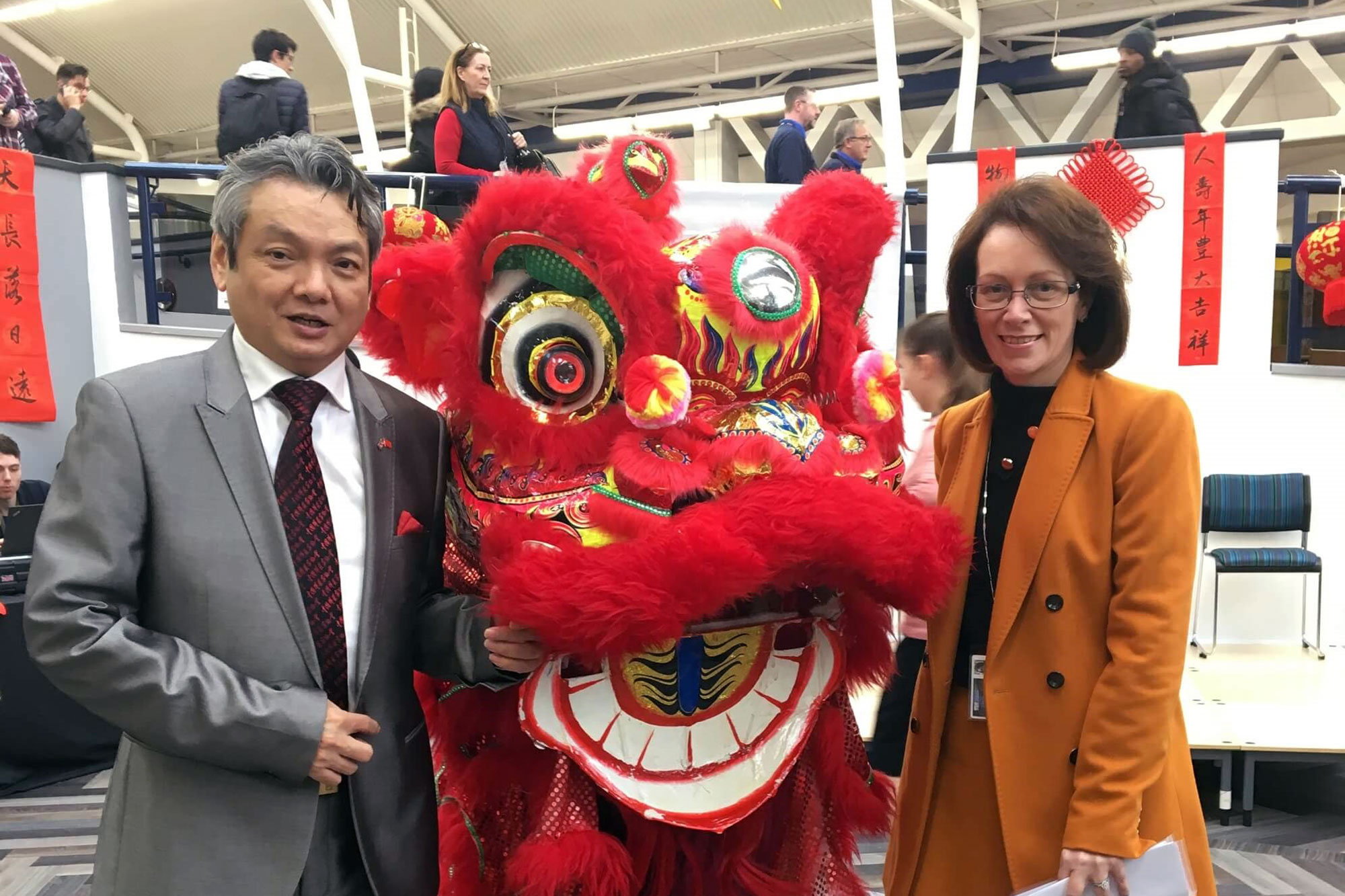 Zheng Xiyuan and Judith Lamie with Chinese Lion for Chinese New Year