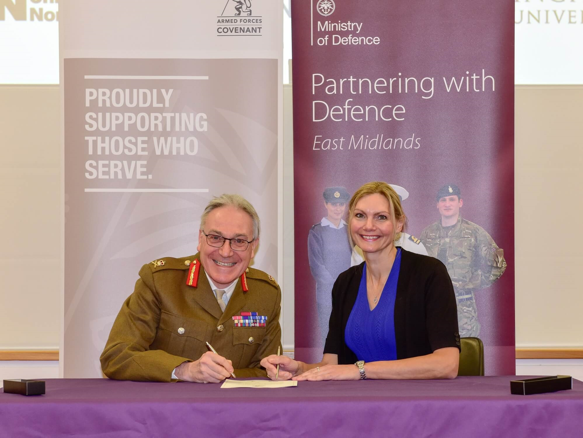 Dr Paula Holt signing the Armed Forces Covenant with Lt Gen Richard Nugee