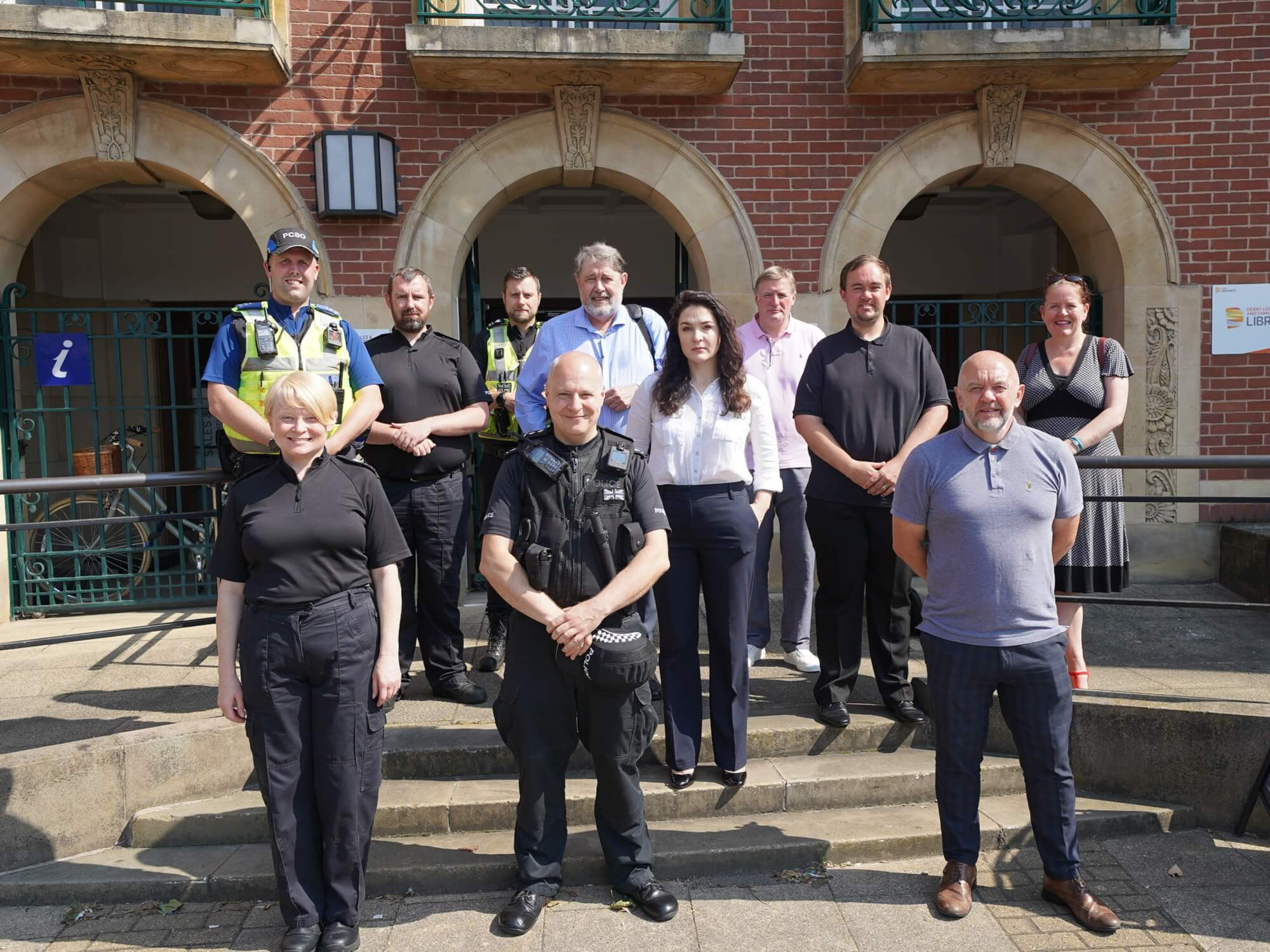 representatives of partner organisations outside the new joint enforcement hub in Derby city centre (July 2021)