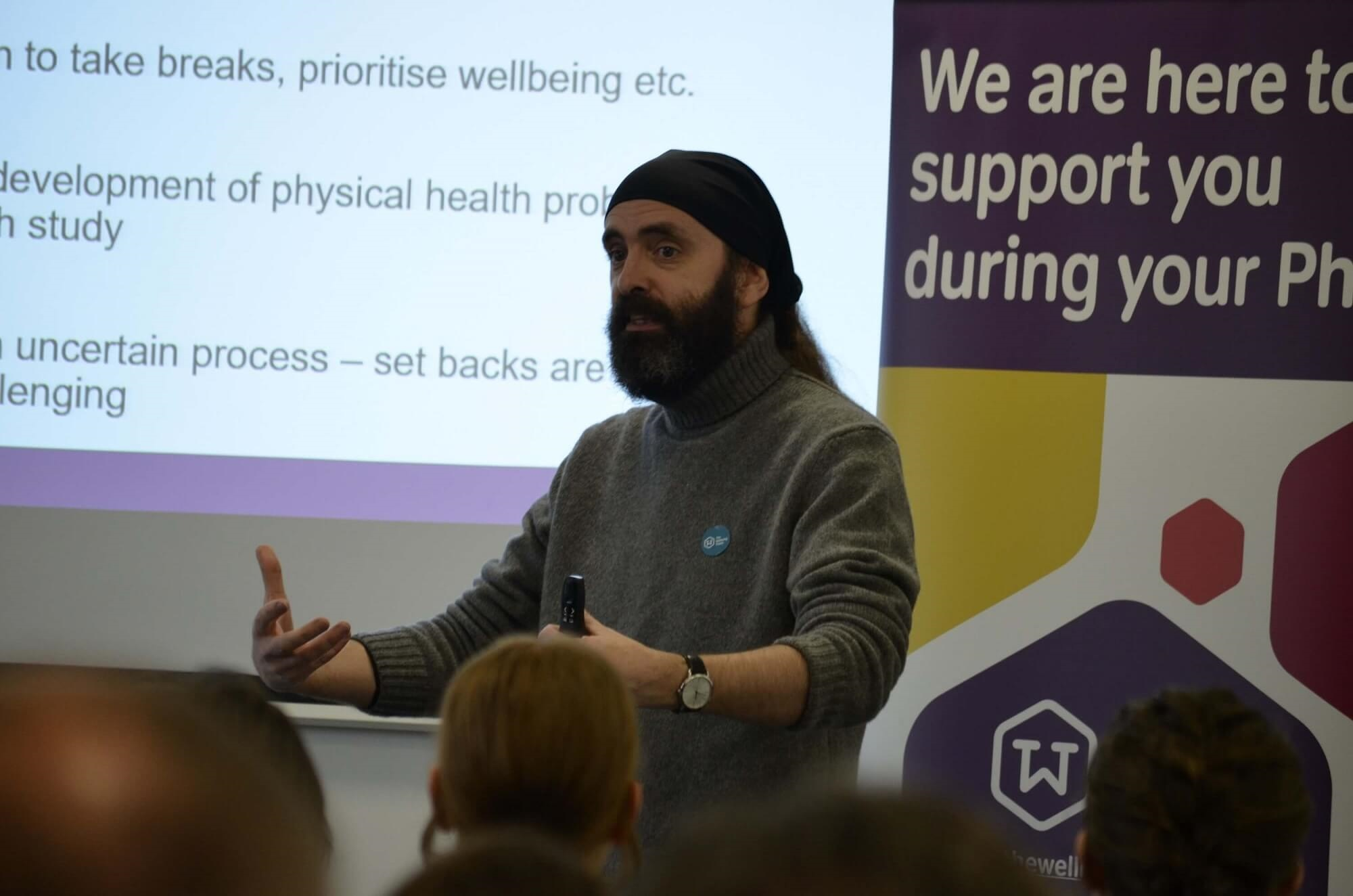 Gareth Hughes delivering a presentation at launch of the Wellbeing Thesis