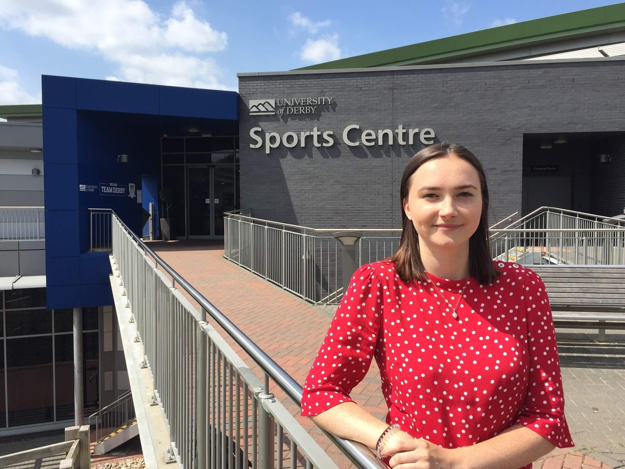 Student Holly Percival standing outside the University of Derby sports centre