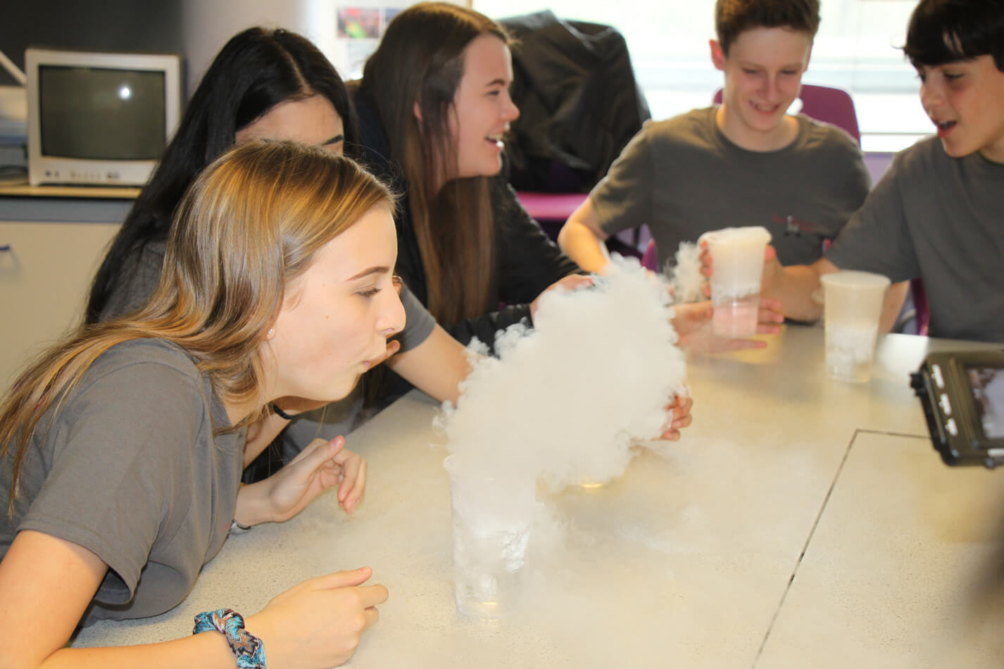 School pupils enjoying science experiments.