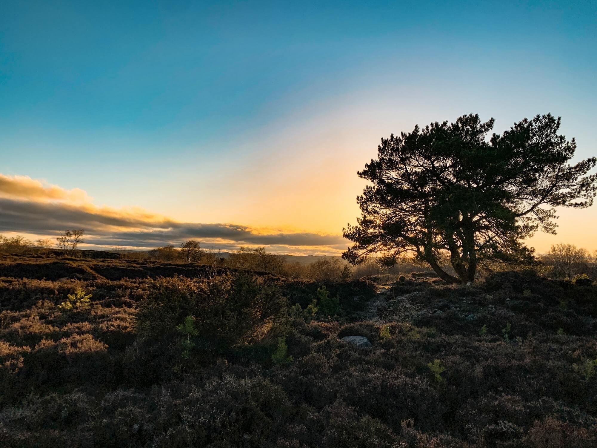 Sun setting over the Peak District landscape