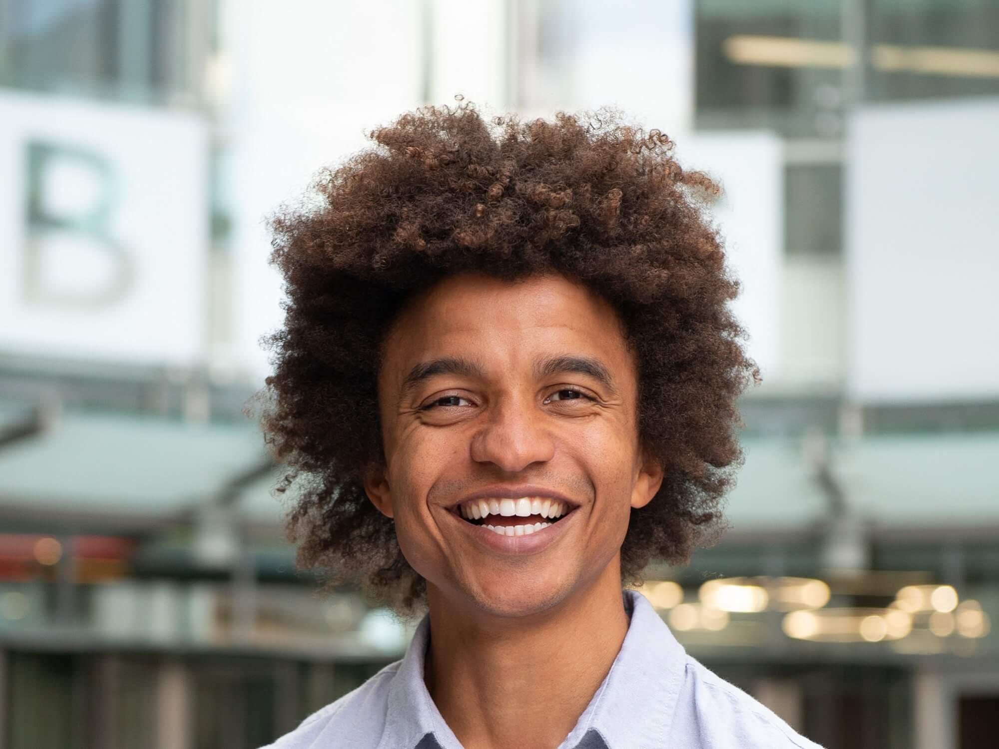 Portrait picture of TV presenter Radzi Chinyanganya