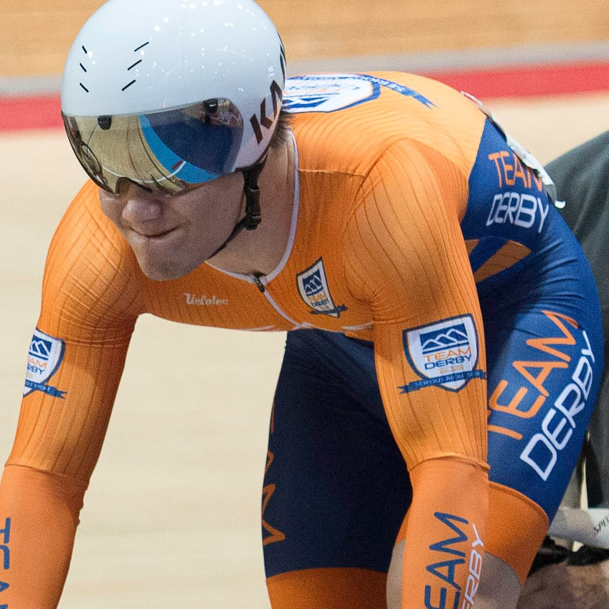 Track cyclist waiting to start race