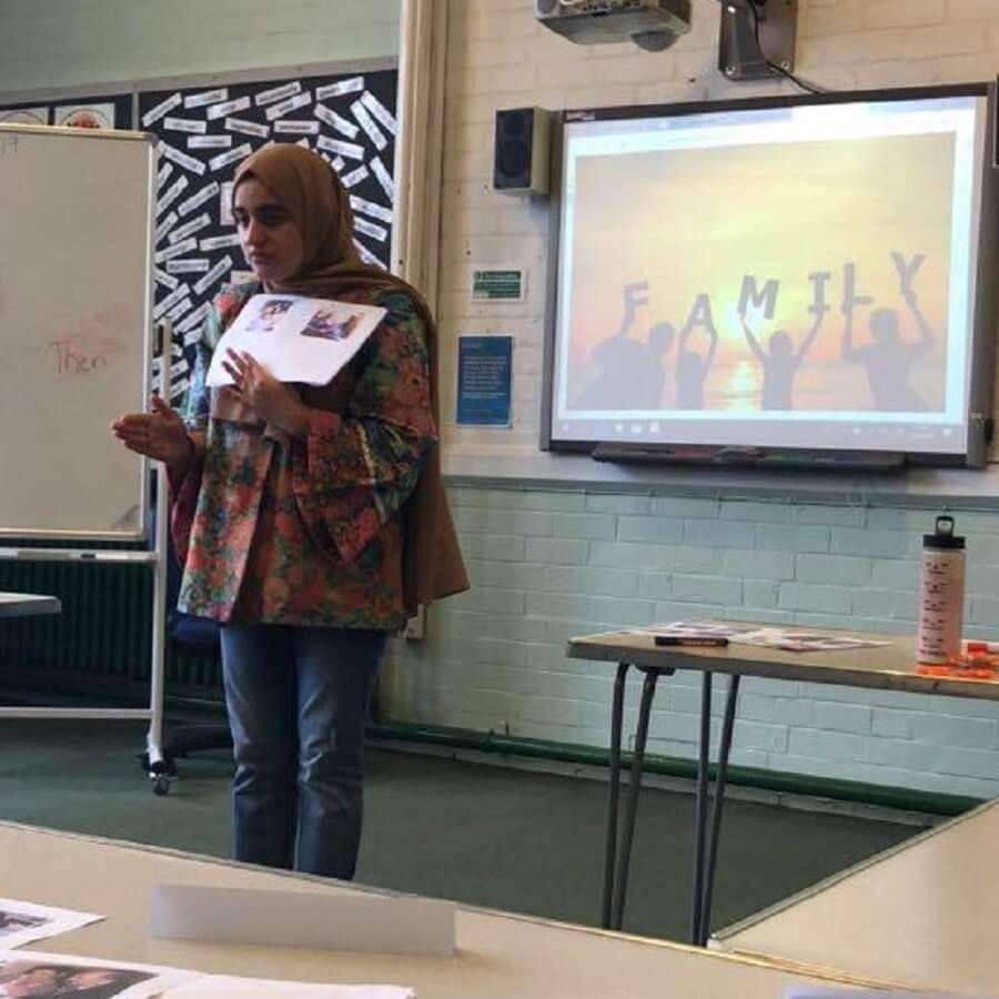 Student Hadiyah Dar teaching English in a classroom