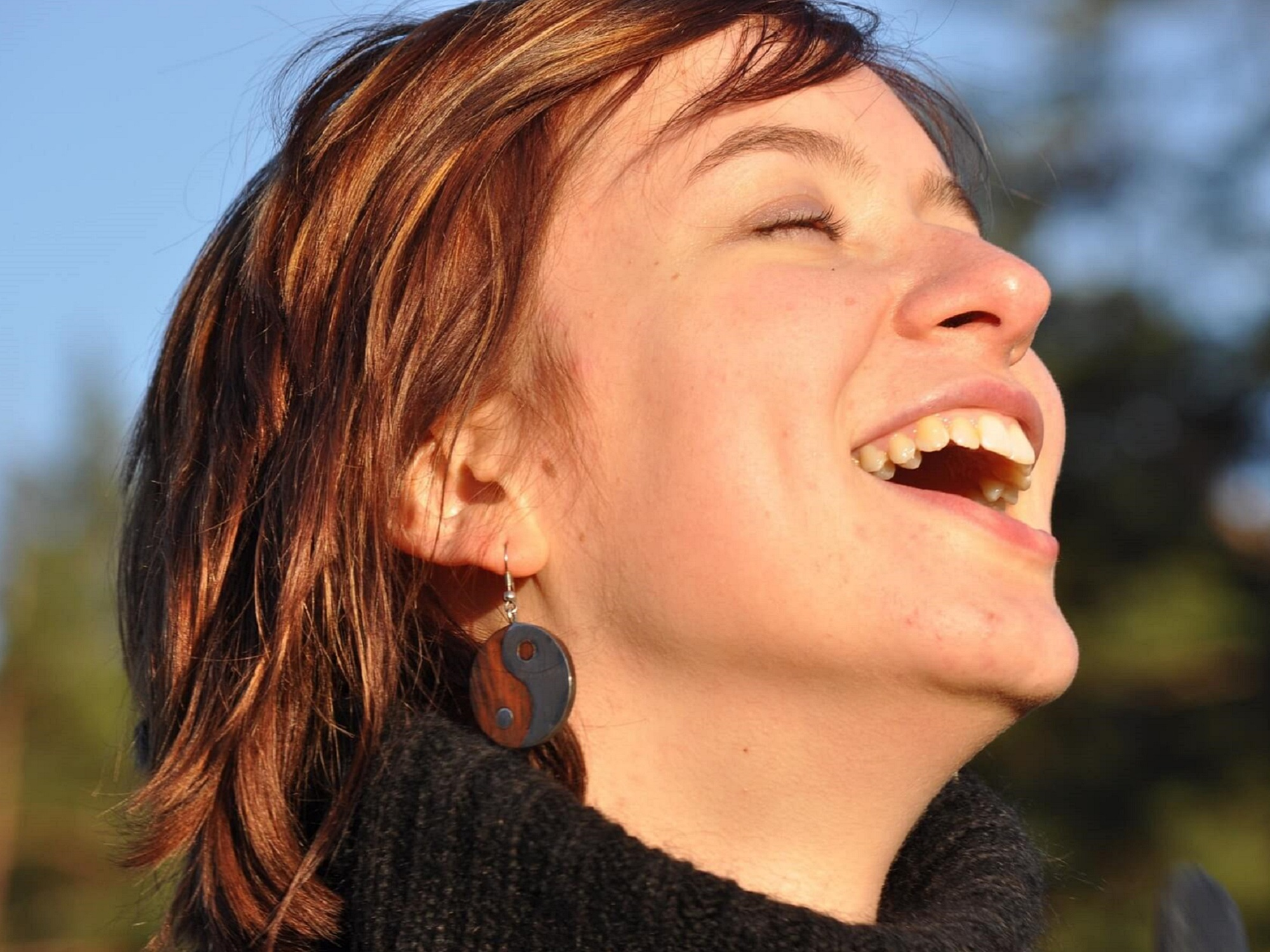 A close-up of a woman laughing