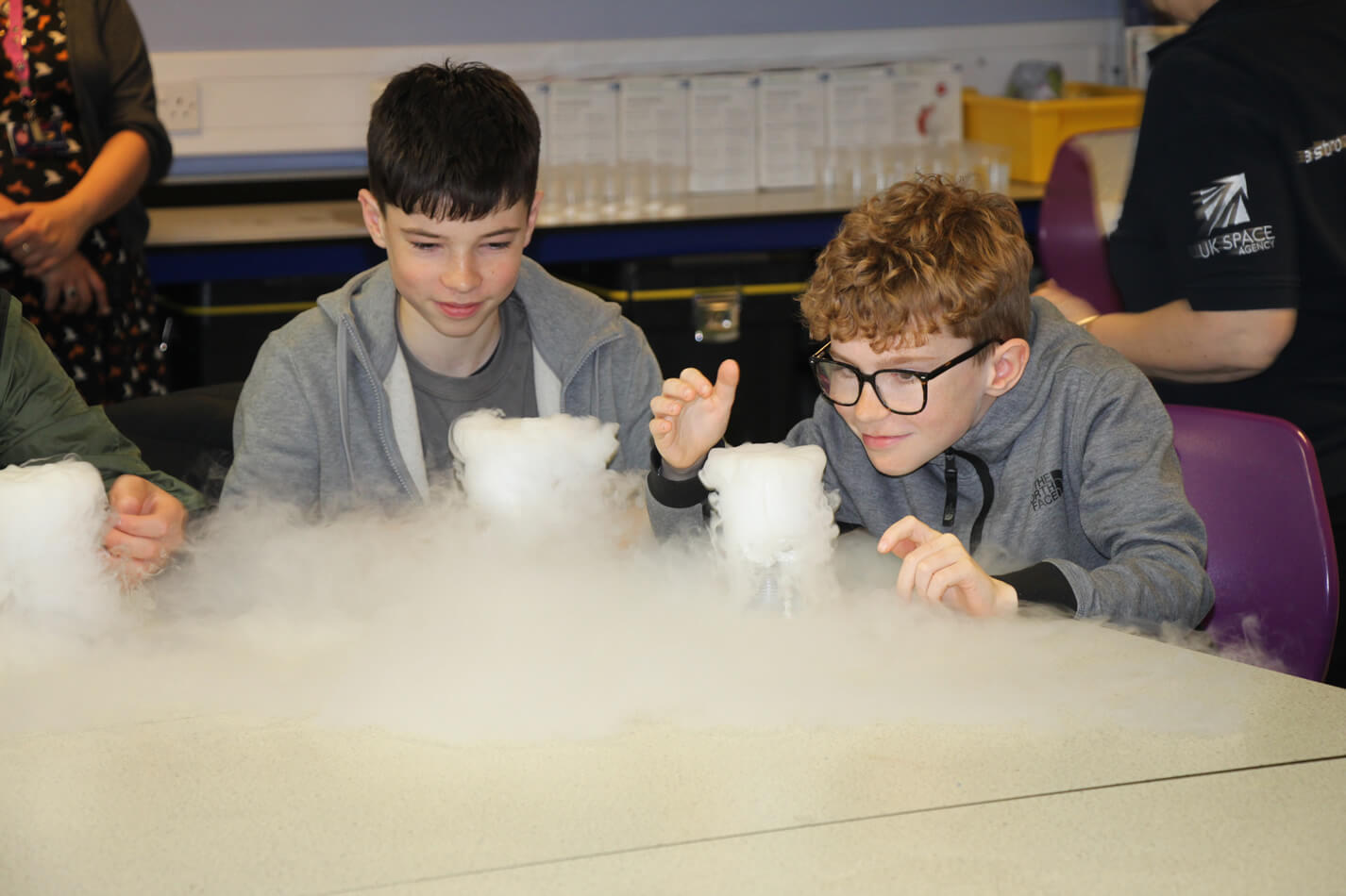 Two school boys doing science experiment.