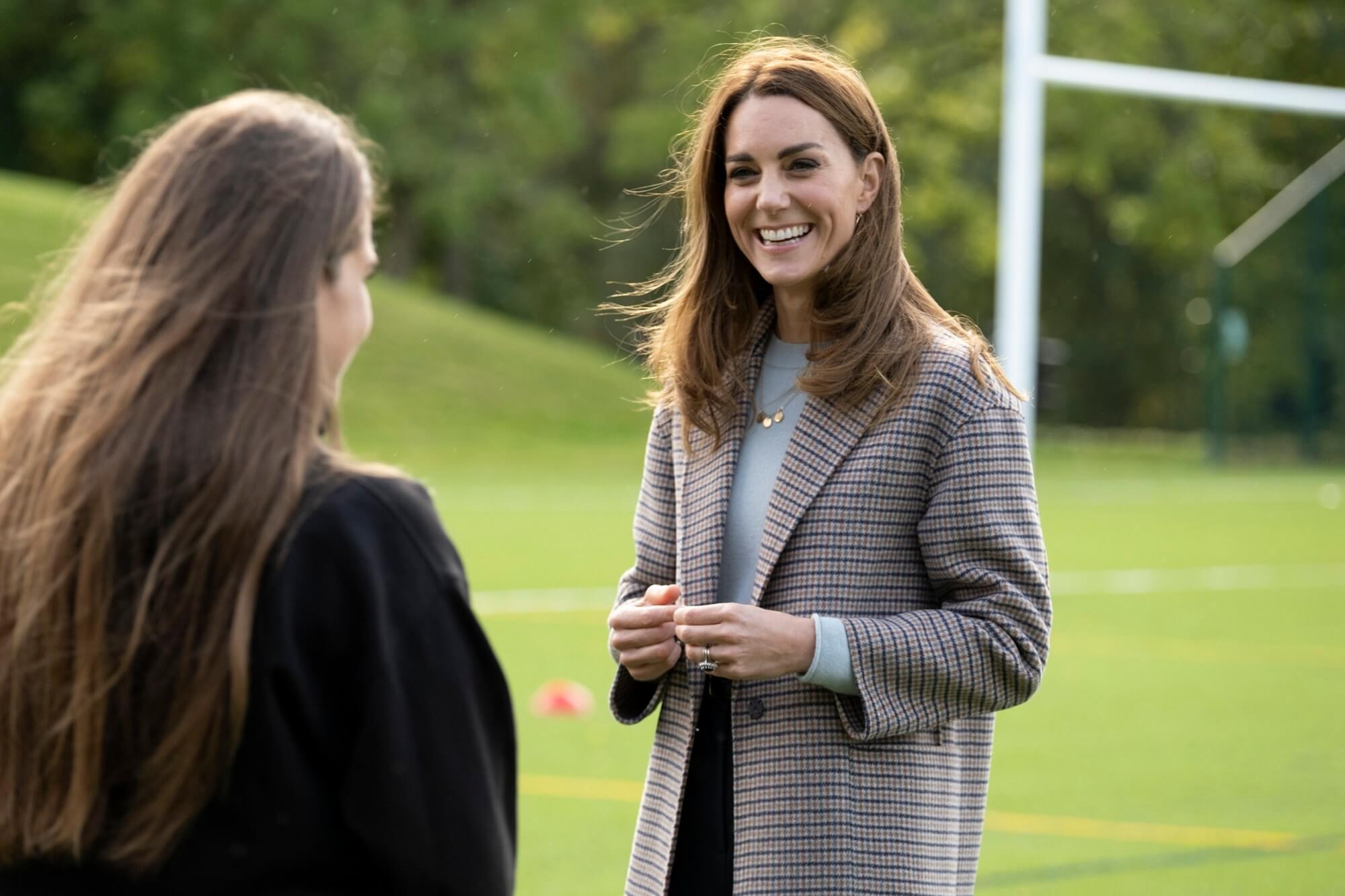 The Duchess of Cambridge talking to a student by the Sports Centre