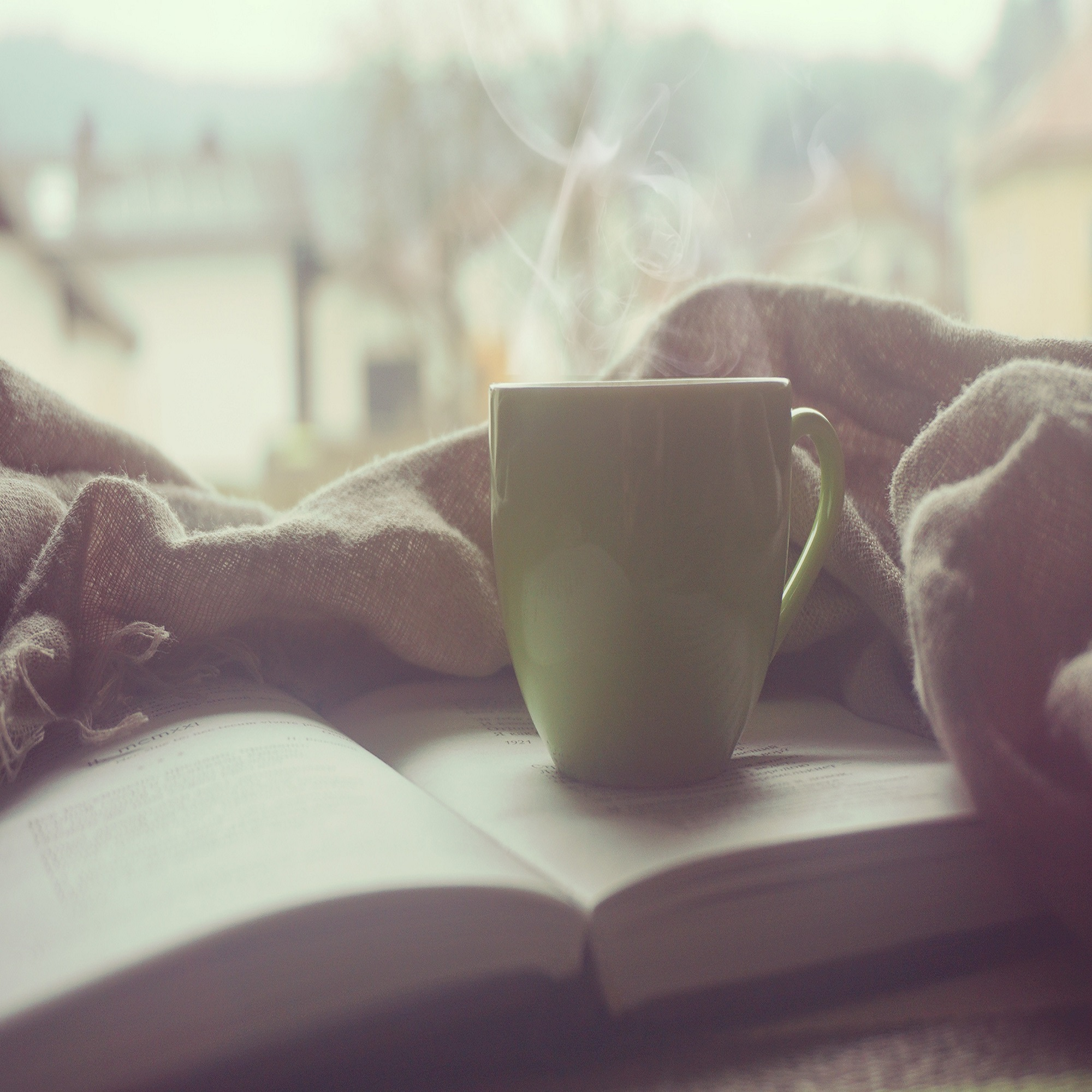 Cup of coffee and book