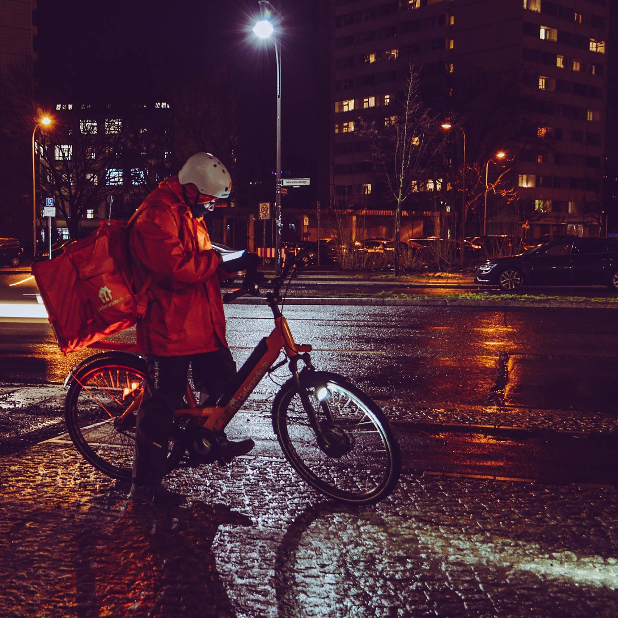 Bike courier at night