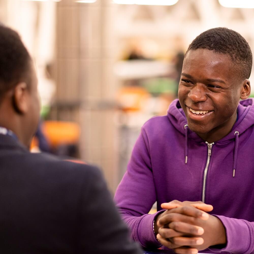 Students chatting in Atrium