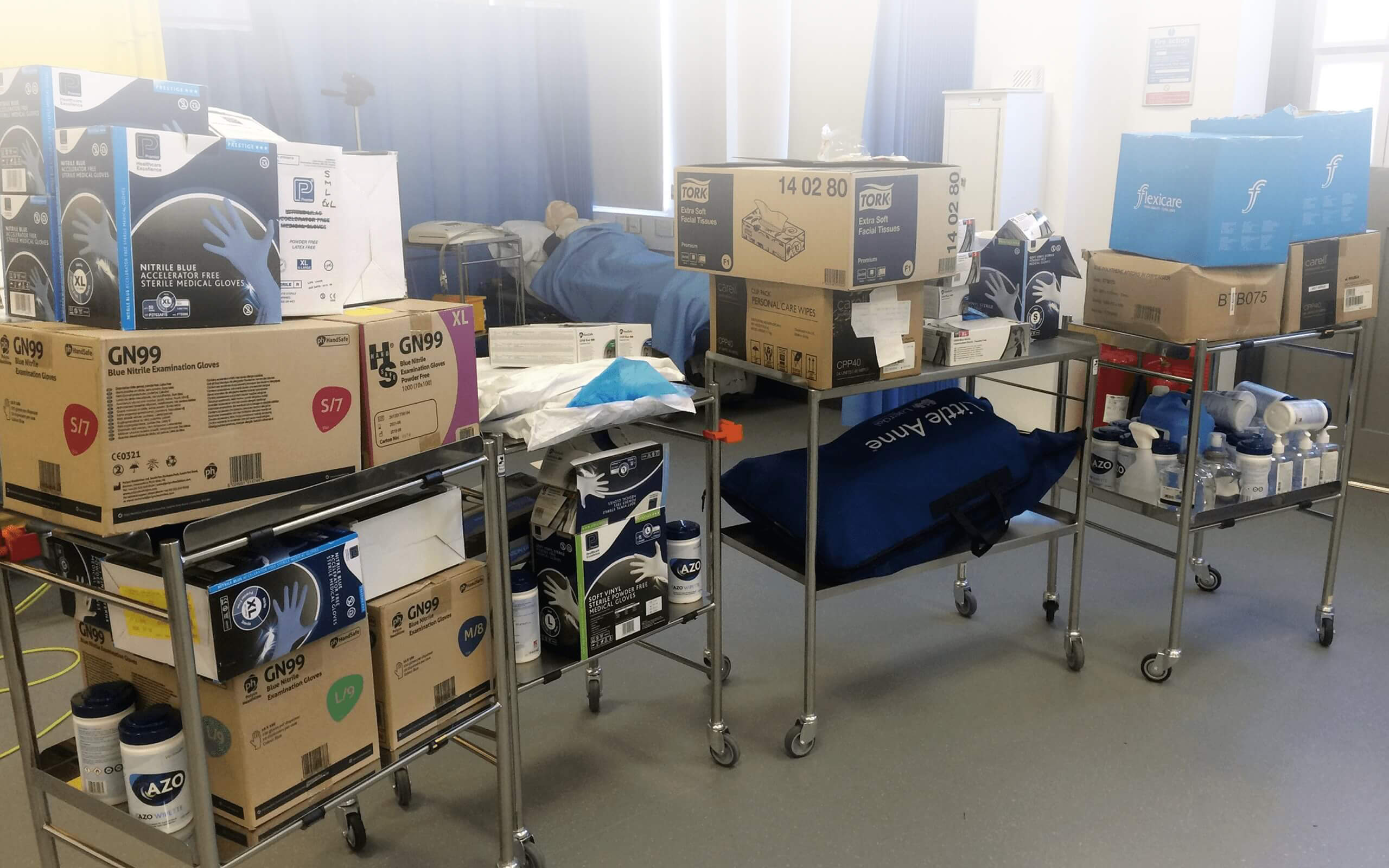 A picture of PPE loaded onto trolleys for delivery to hospitals